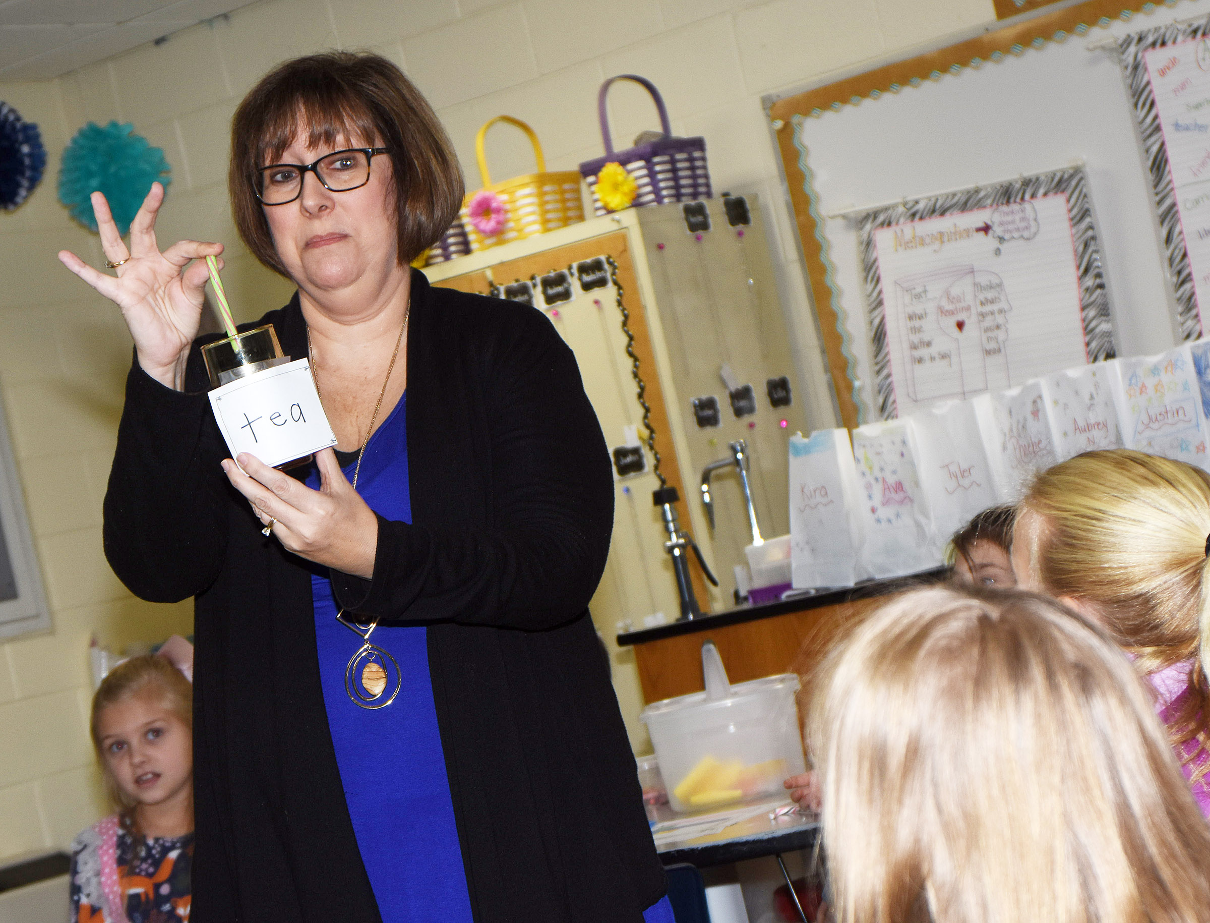 CES second-grade teacher Lynne Horn places a candy cane in tea to show her students the reaction.