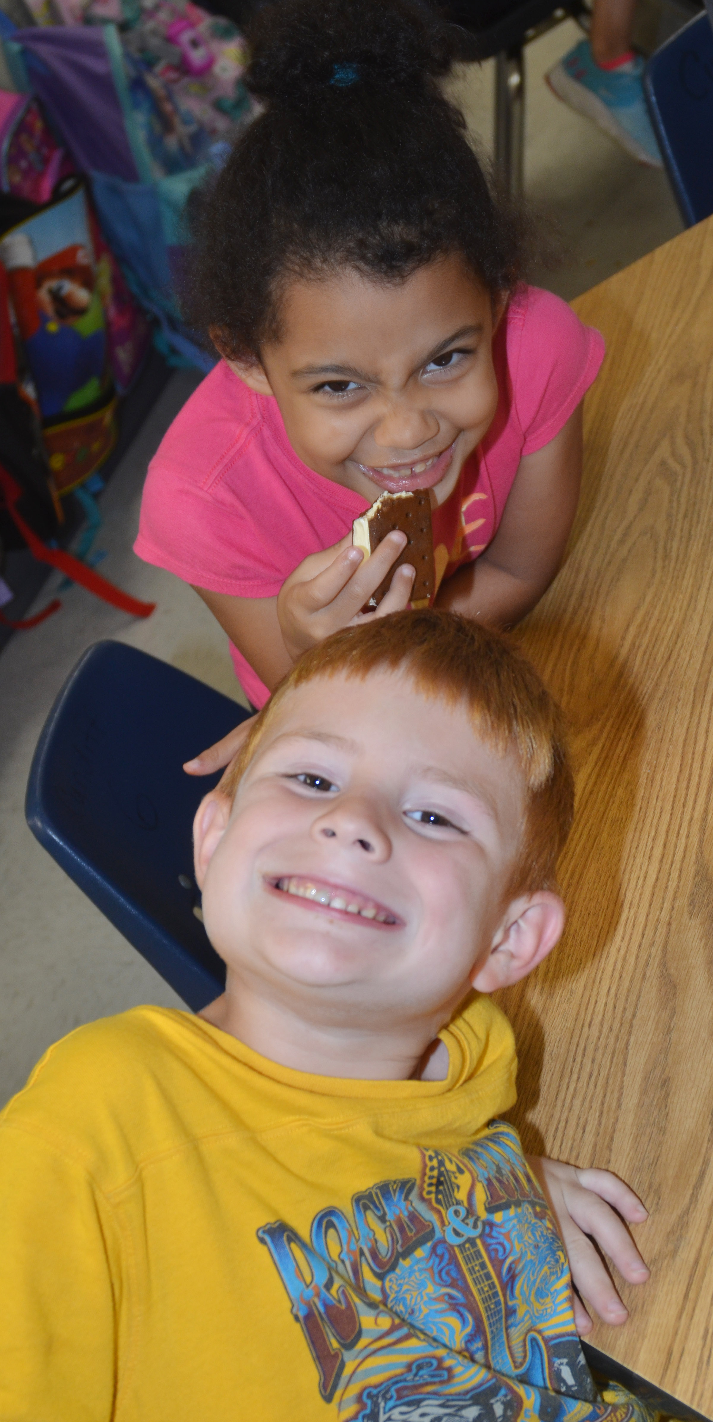 CES kindergartener Rylee Karr enjoys her ice cream sandwich with classmate Kennon Dobson.