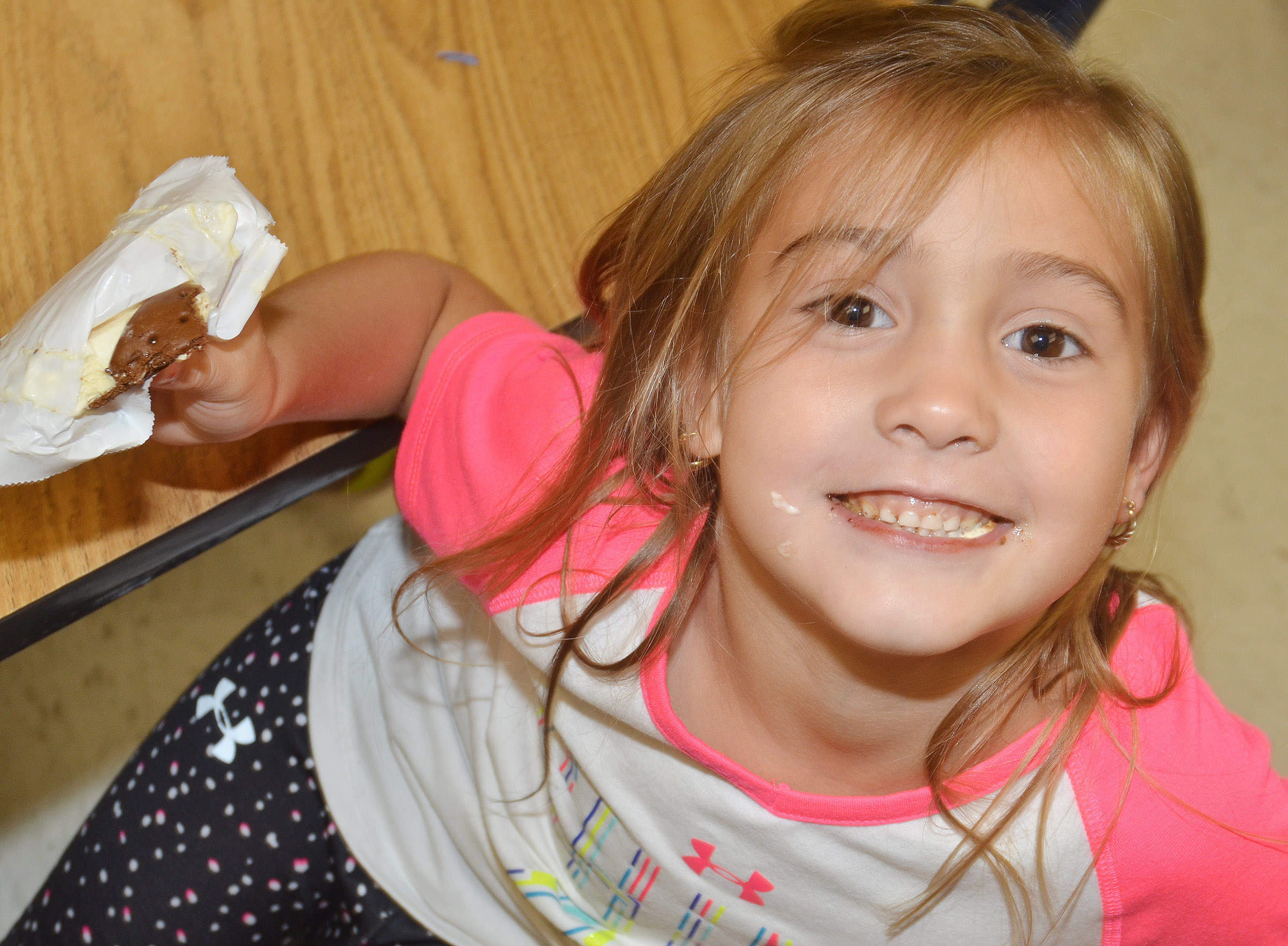 CES kindergartener Blakely Gray smiles as she enjoys her ice cream sandwich.