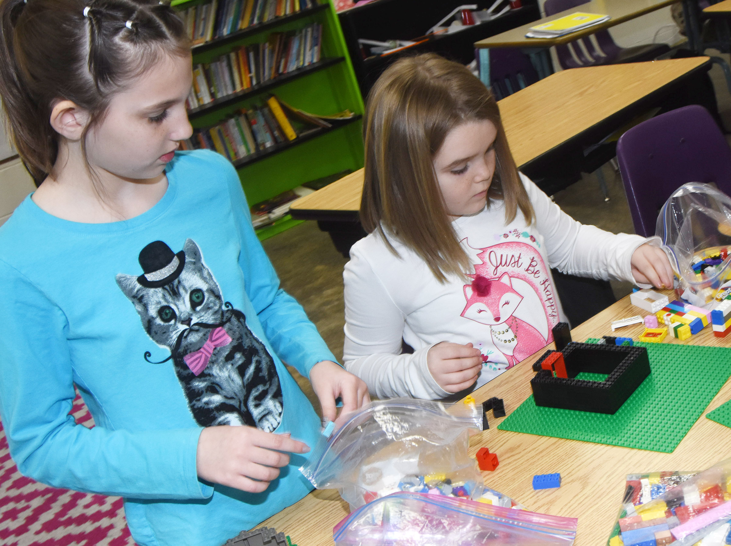 CES fourth-graders Kairi Tucker, at left, and Jaylin Christie build with Legos.