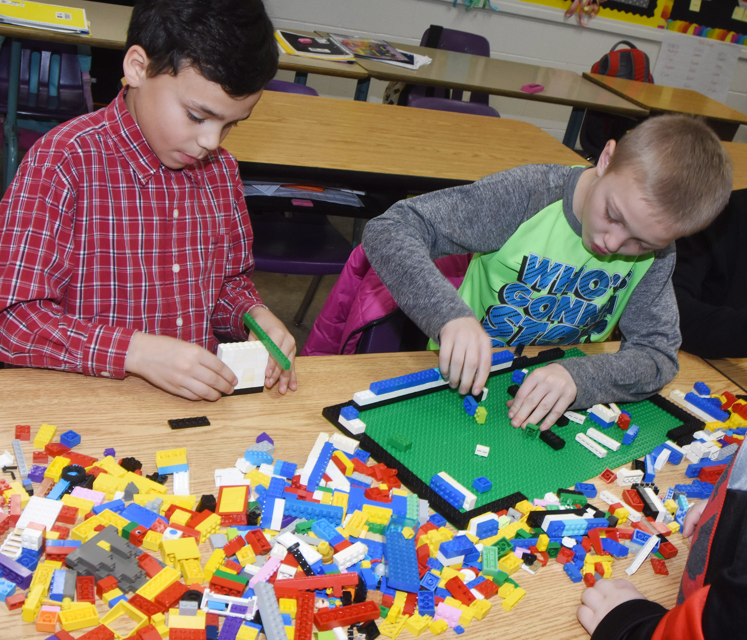 CES fourth-graders Donnaven Phillips, at left, and Trenton Harris build with Legos.