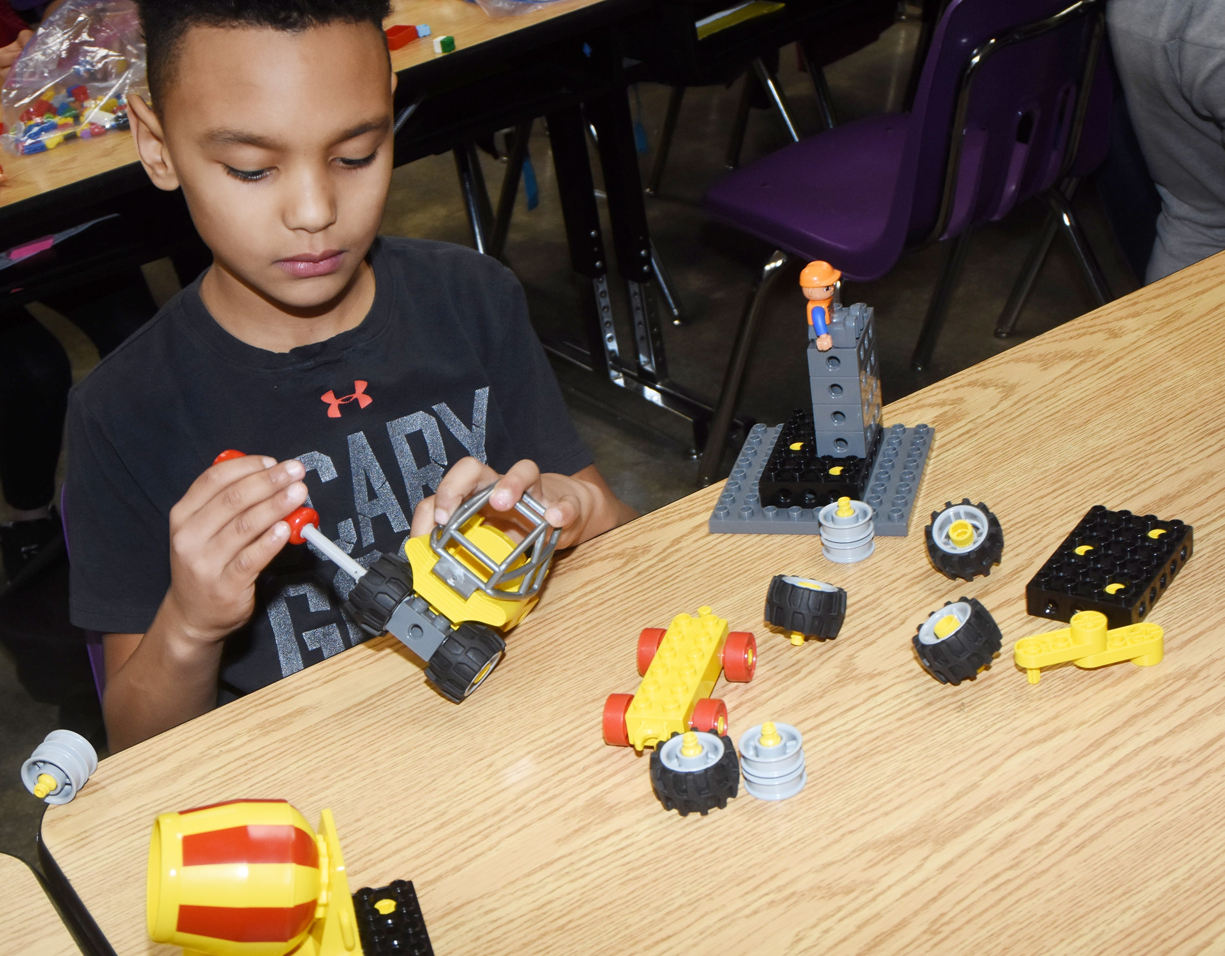 CES fourth-grader Maddox Hawkins builds with Legos.