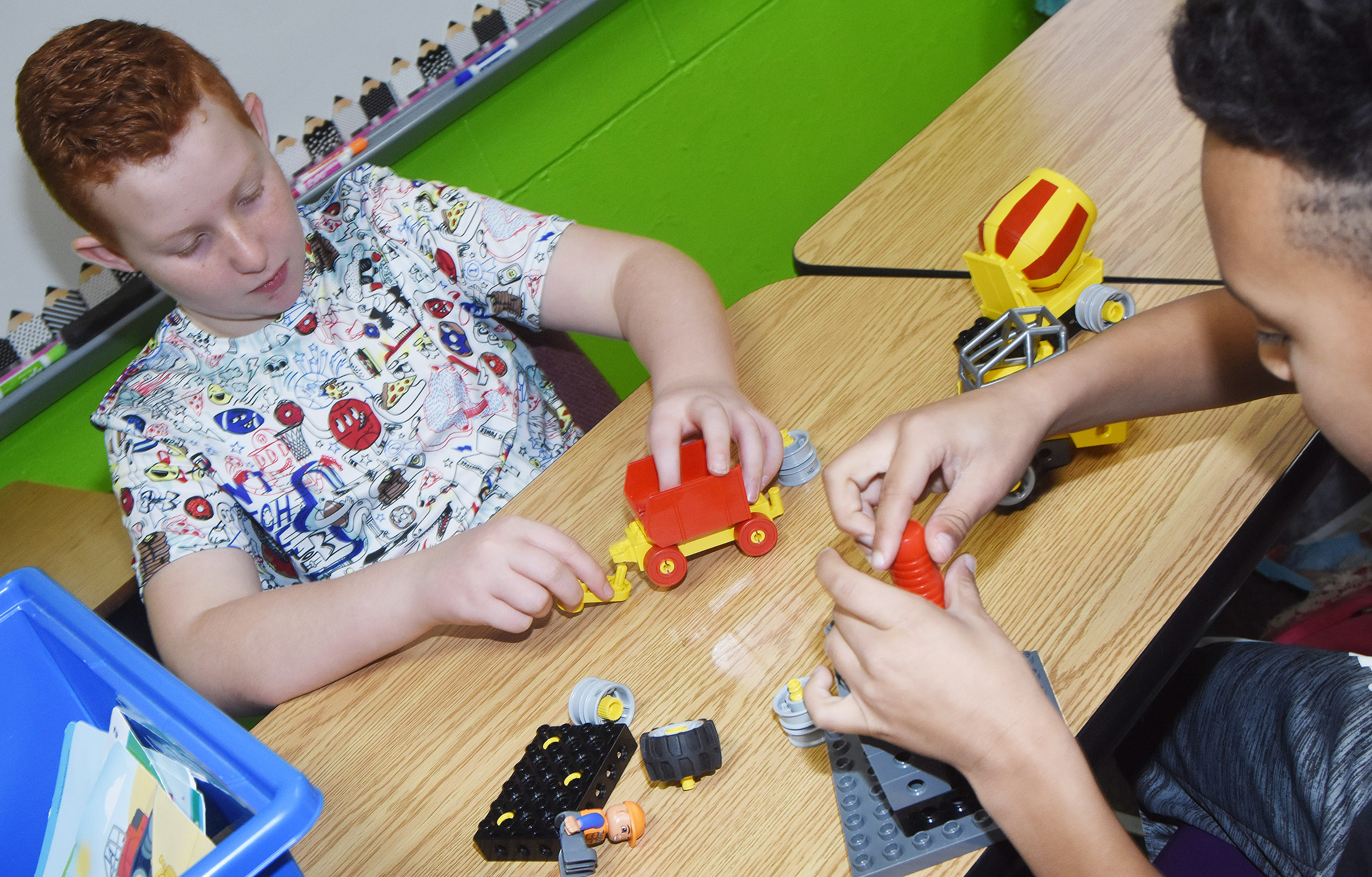 CES fourth-graders Reece Swafford, at left, and Maddox Hawkins build with Legos.