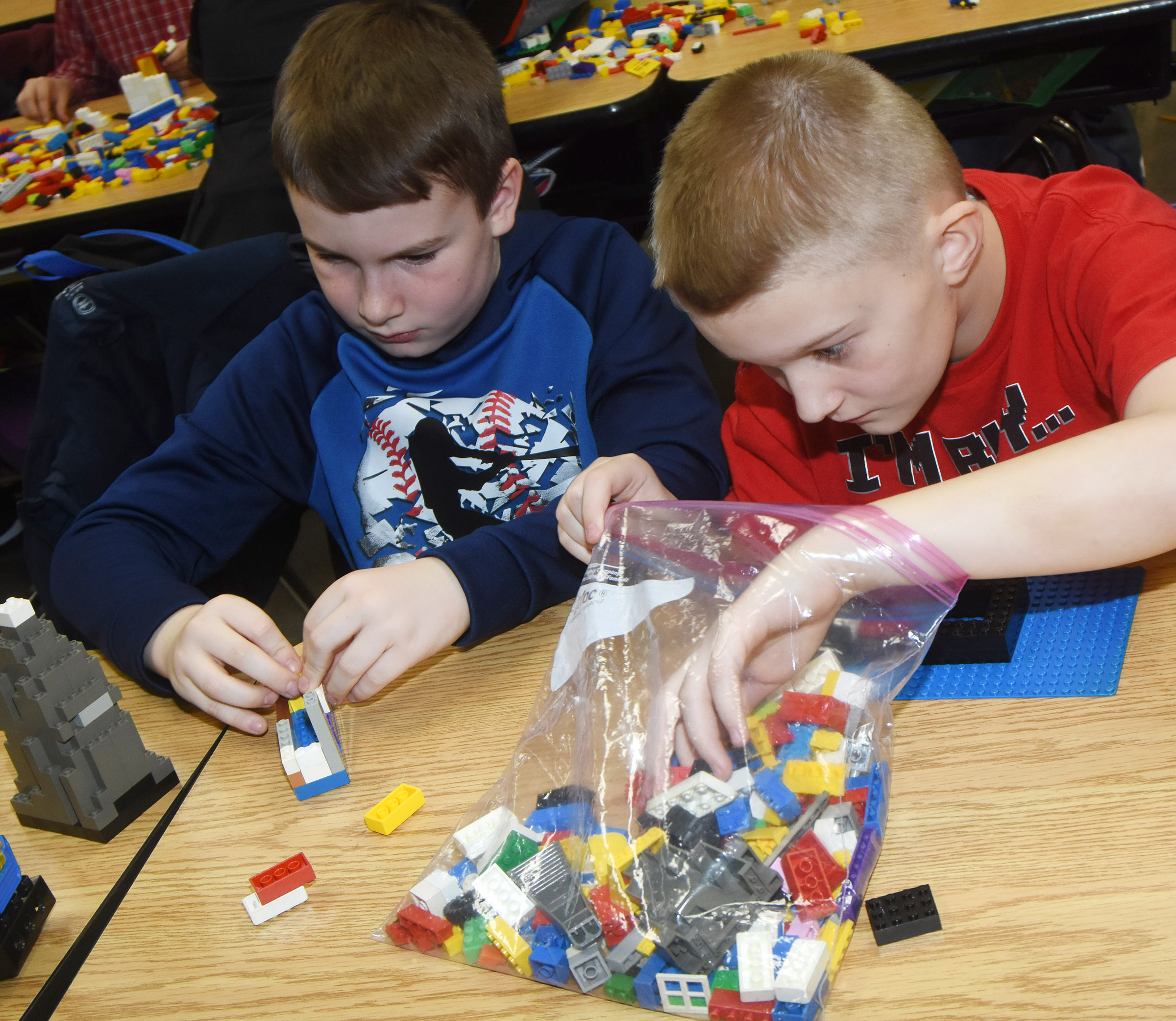 CES fourth-graders Stephen Green, at left, and Camren Skaggs build with Legos.