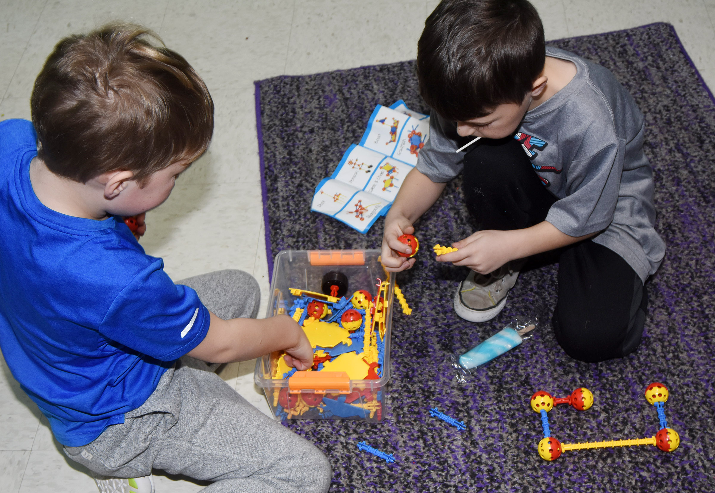 CES first-graders Landry Brown, at left, and Bentley Wilhoite build together.