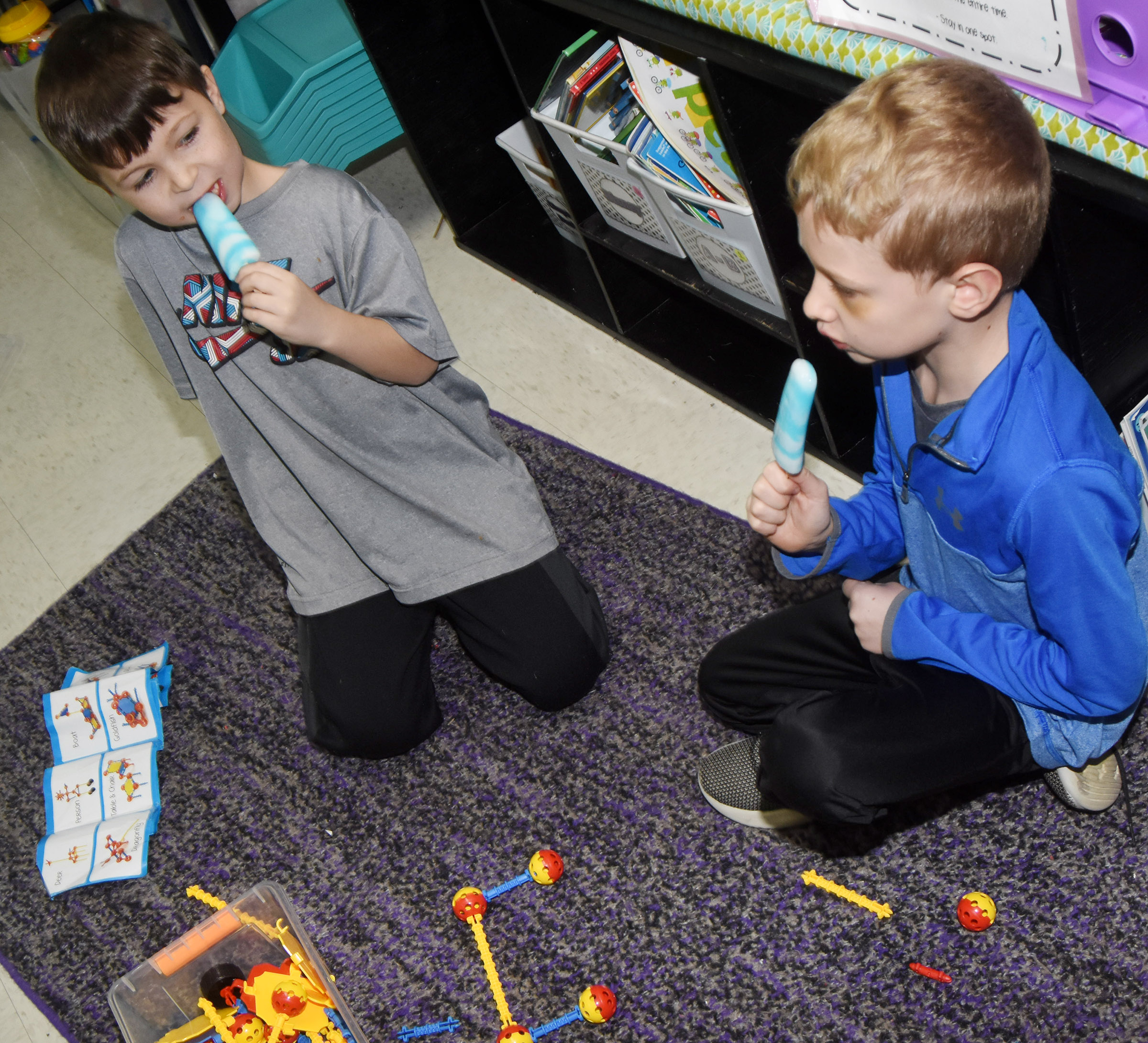 CES first-graders Bentley Wilhoite, at left, and Jackson Wright enjoy popsicles as they build together.