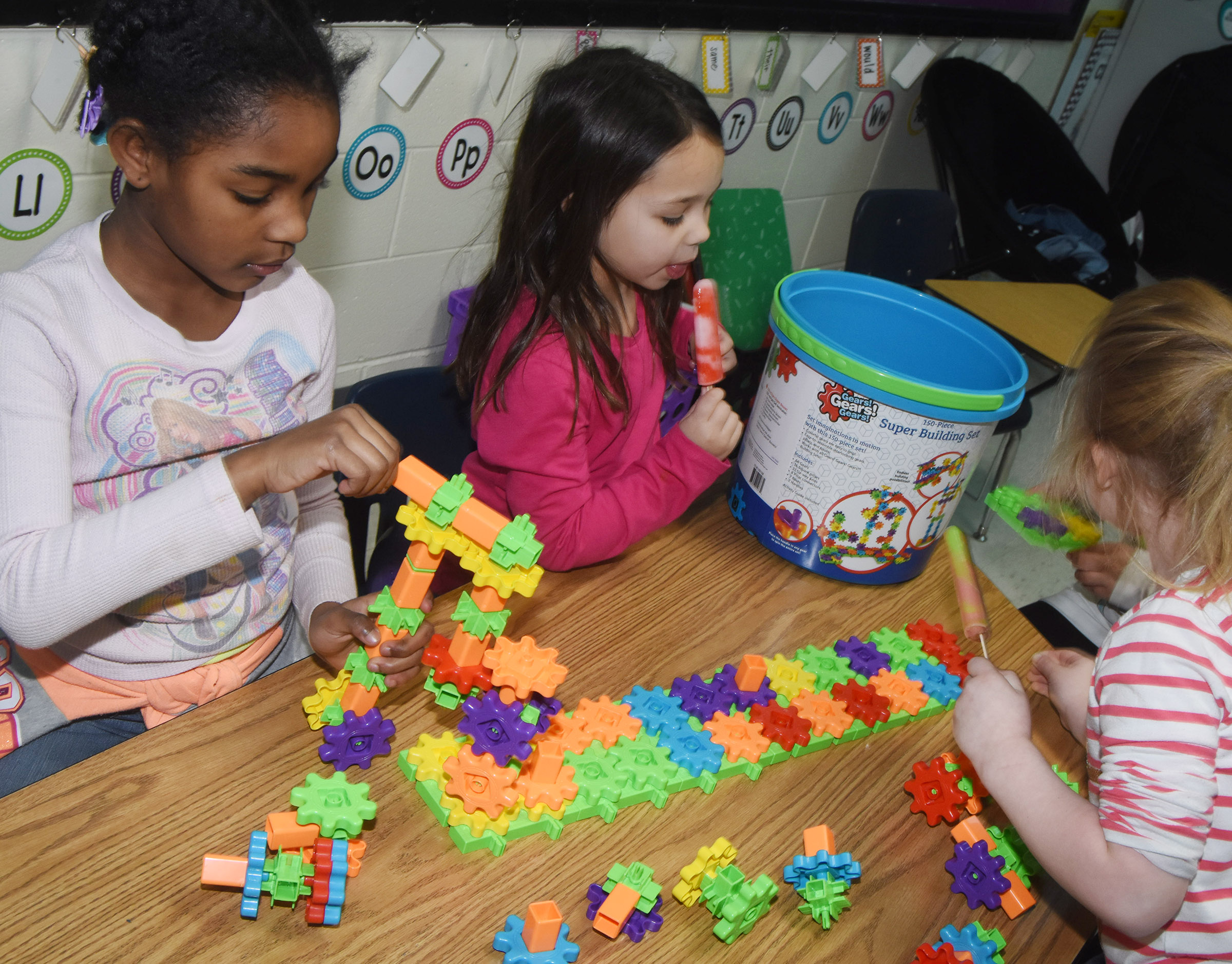 From left, CES first-graders Mariah Harris, Tylee Britton and Macilynn Mann build together.