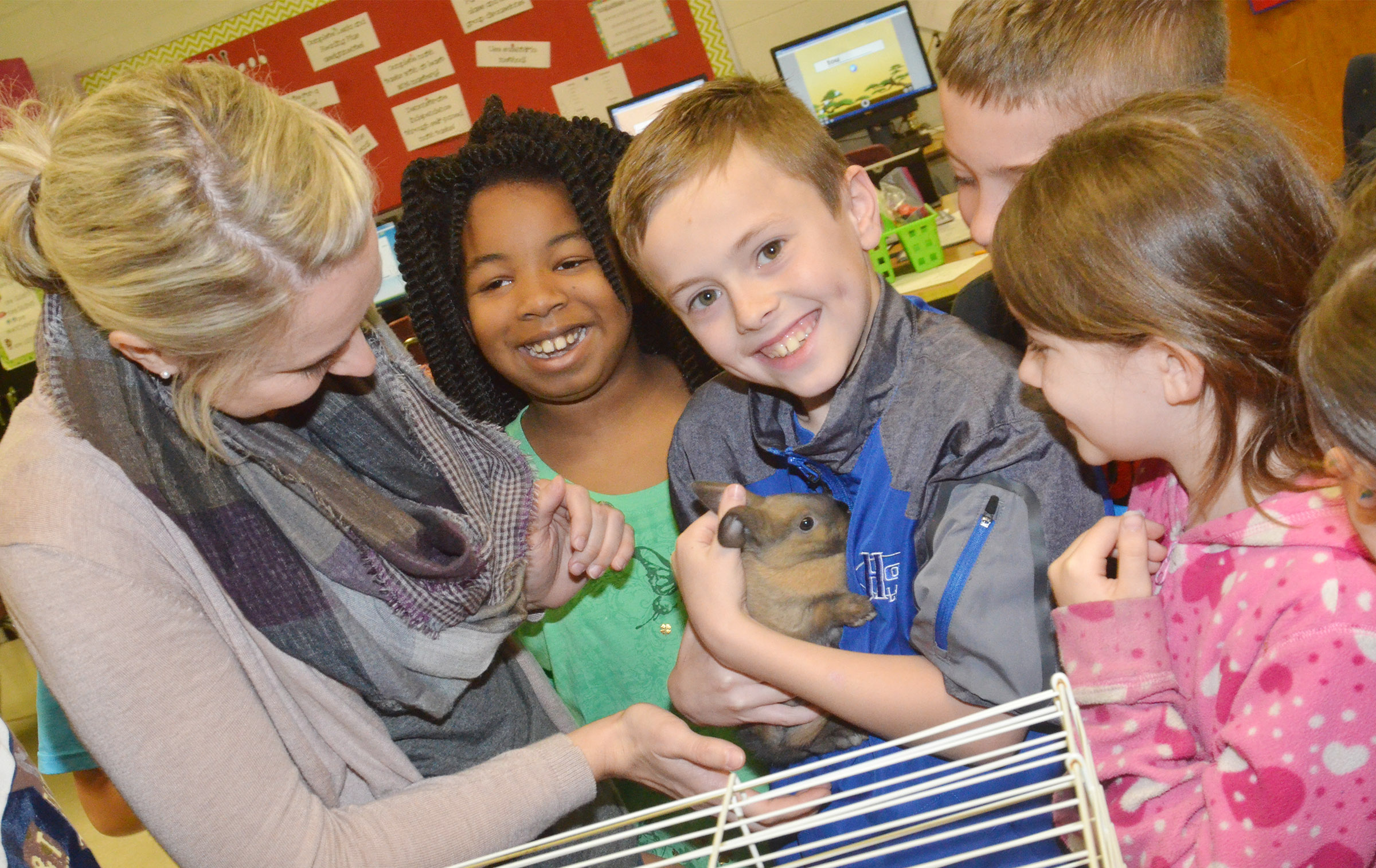 CES third-grader Keaton Hord holds one of the class's rabbits.