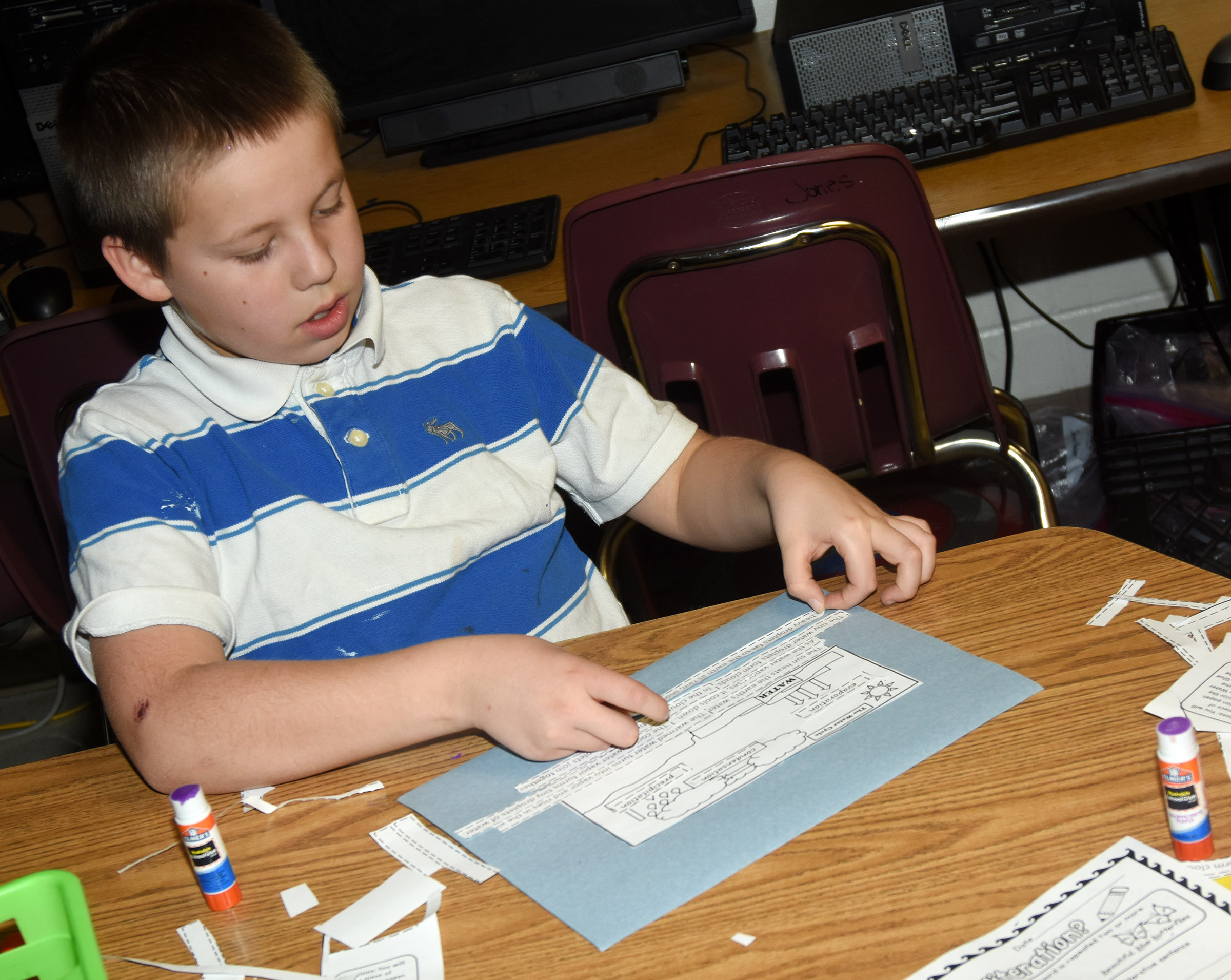 CES third-grader David McFarland places the steps to the water cycle in order.