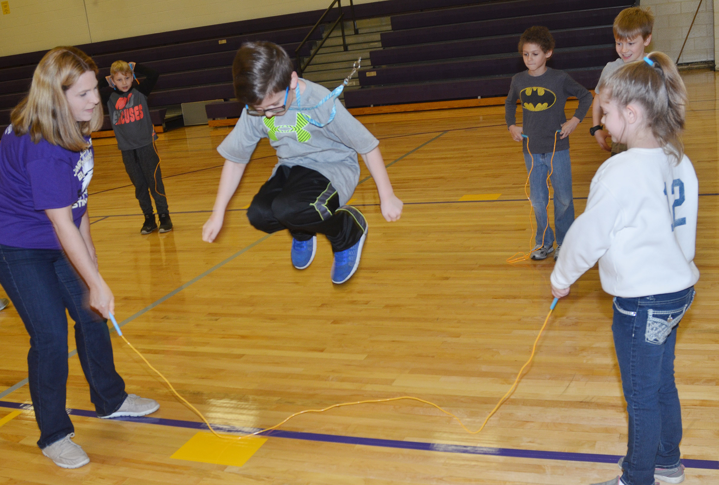 CES Guidance Counselor Sonya Orberson, at left, and third-grader Chyanne Christie jump rope with second-grader Tye Rhodes.