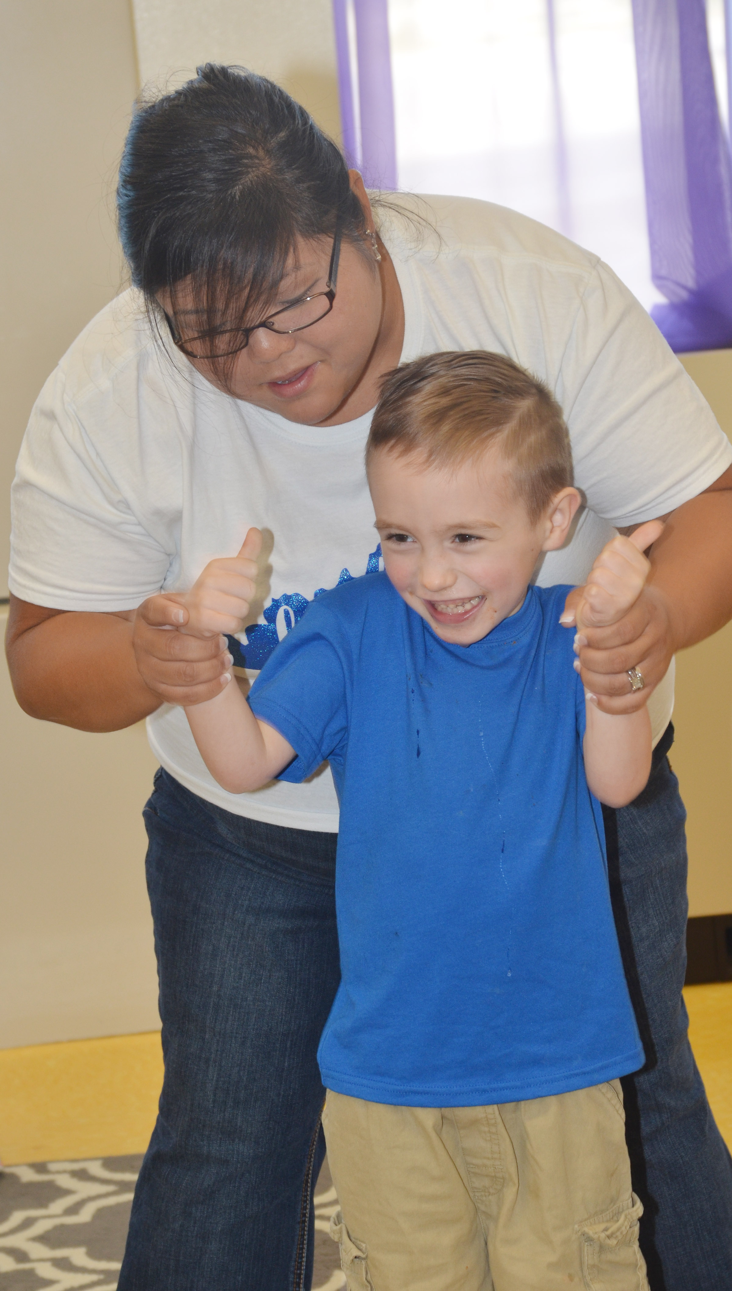 CES kindergartener Joshua Dickens dances with instructional assistant Brittany Johnson.