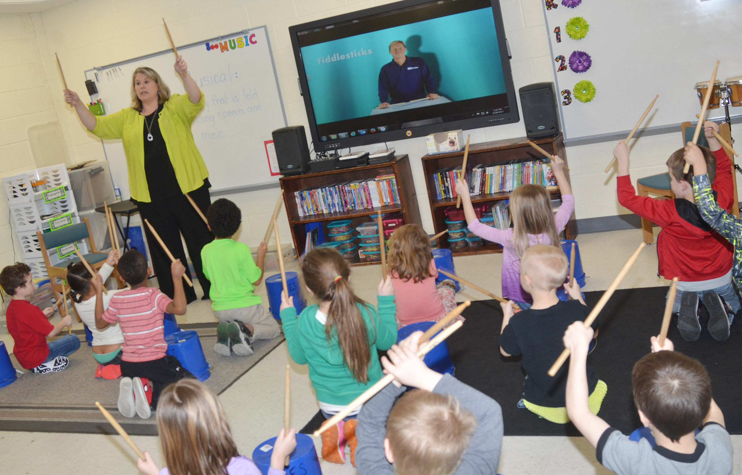 CES music teacher Cyndi Chadwick teaches kindergarten students how to keep a steady rhythm.