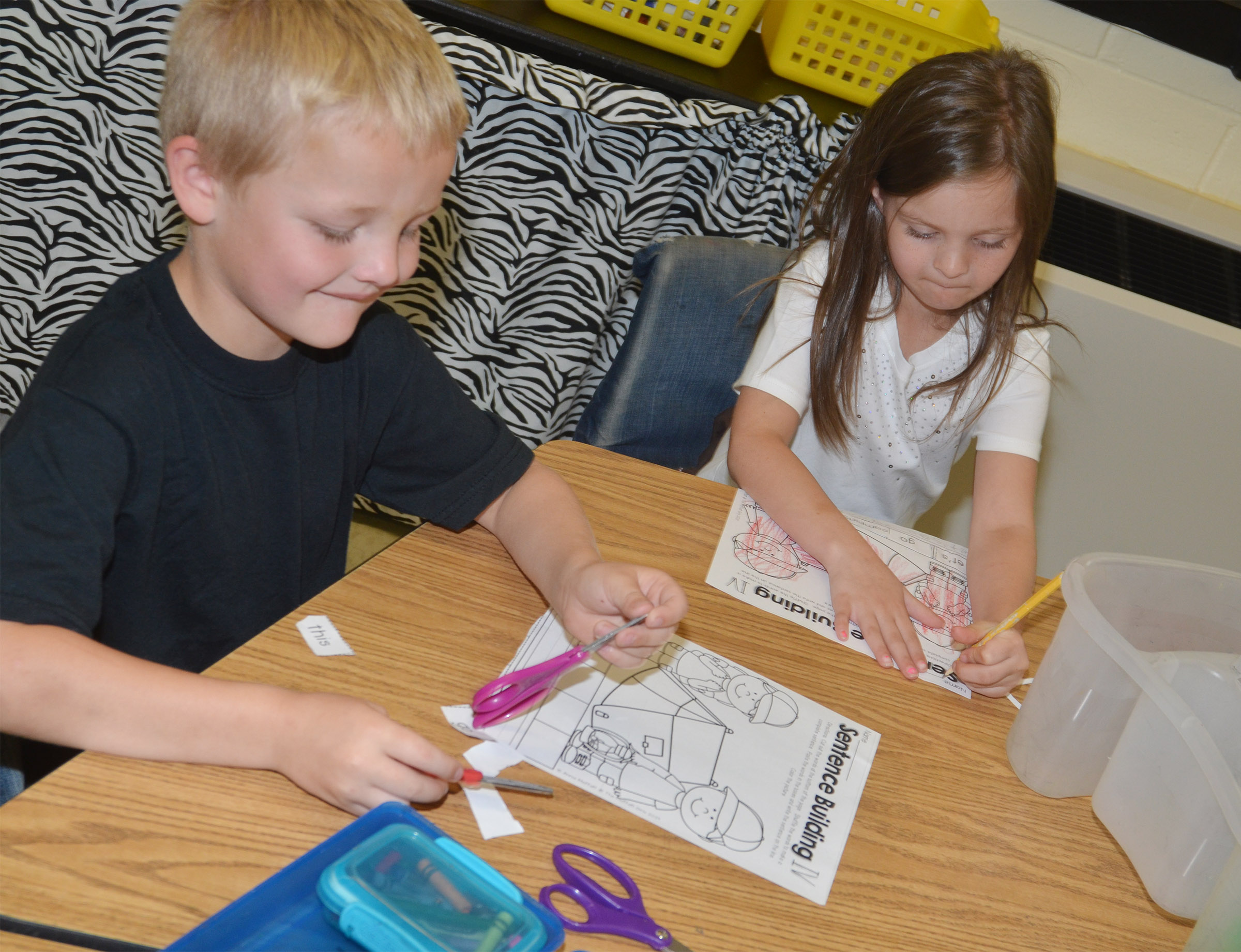 CES kindergarteners Tristian Harris, at left, and Addison Perkins work on their worksheets.