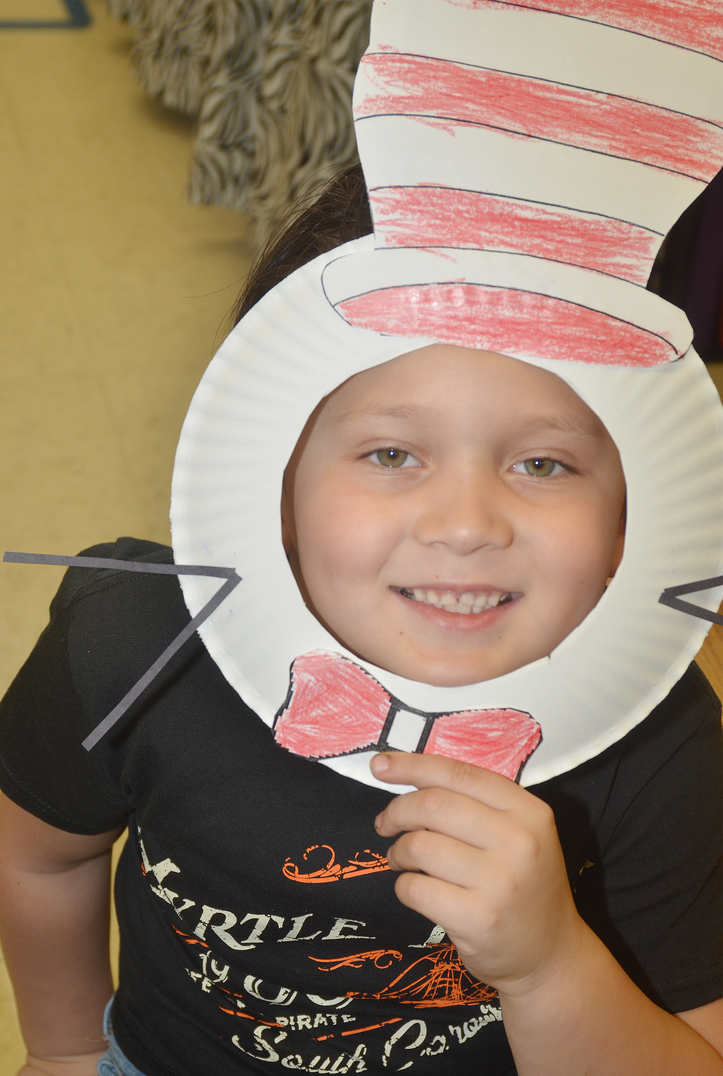CES kindergartener Karter Young wears his Cat in the Hat mask.