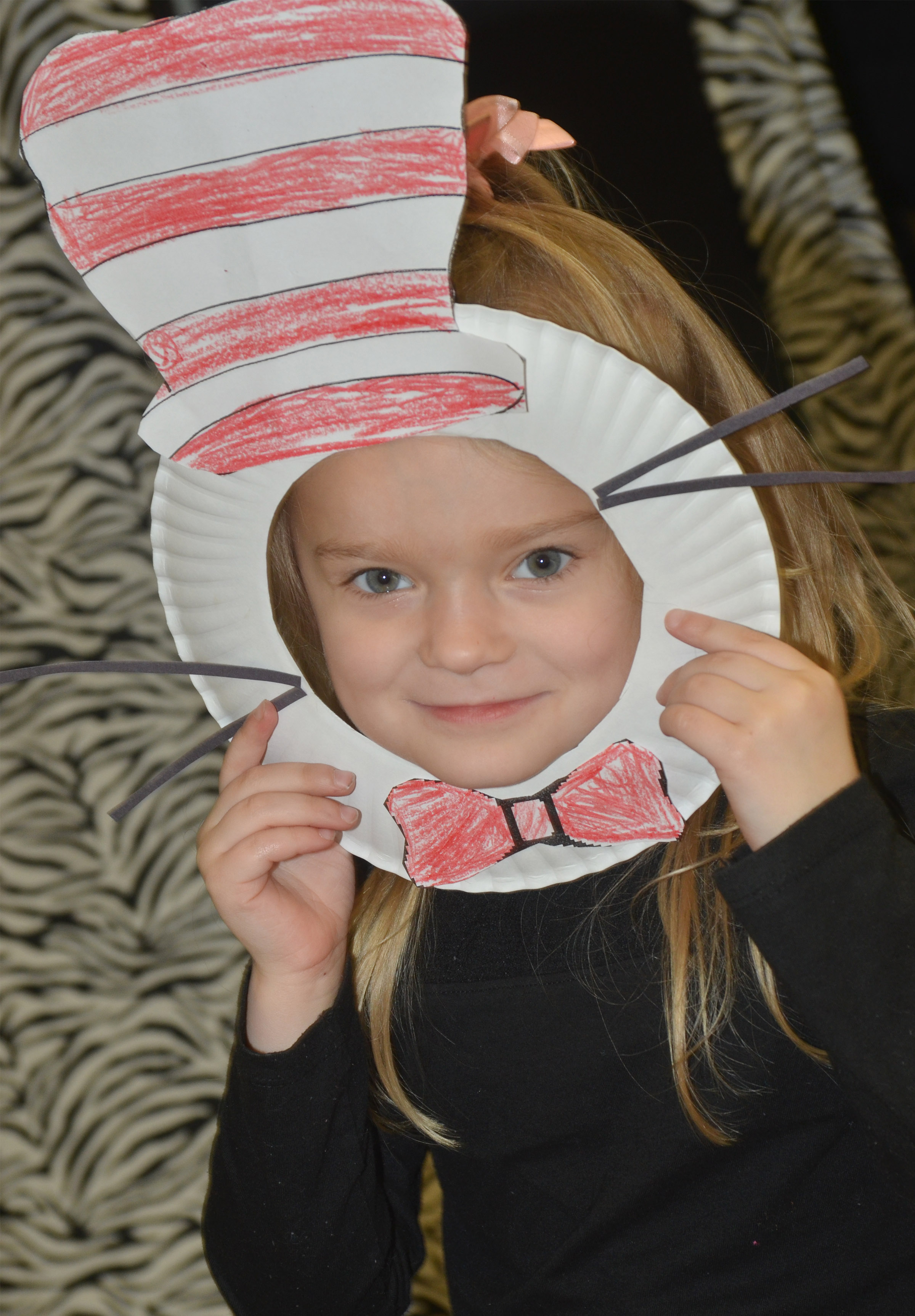 CES kindergartner Miley Orberson wears her Cat in the Hat mask.