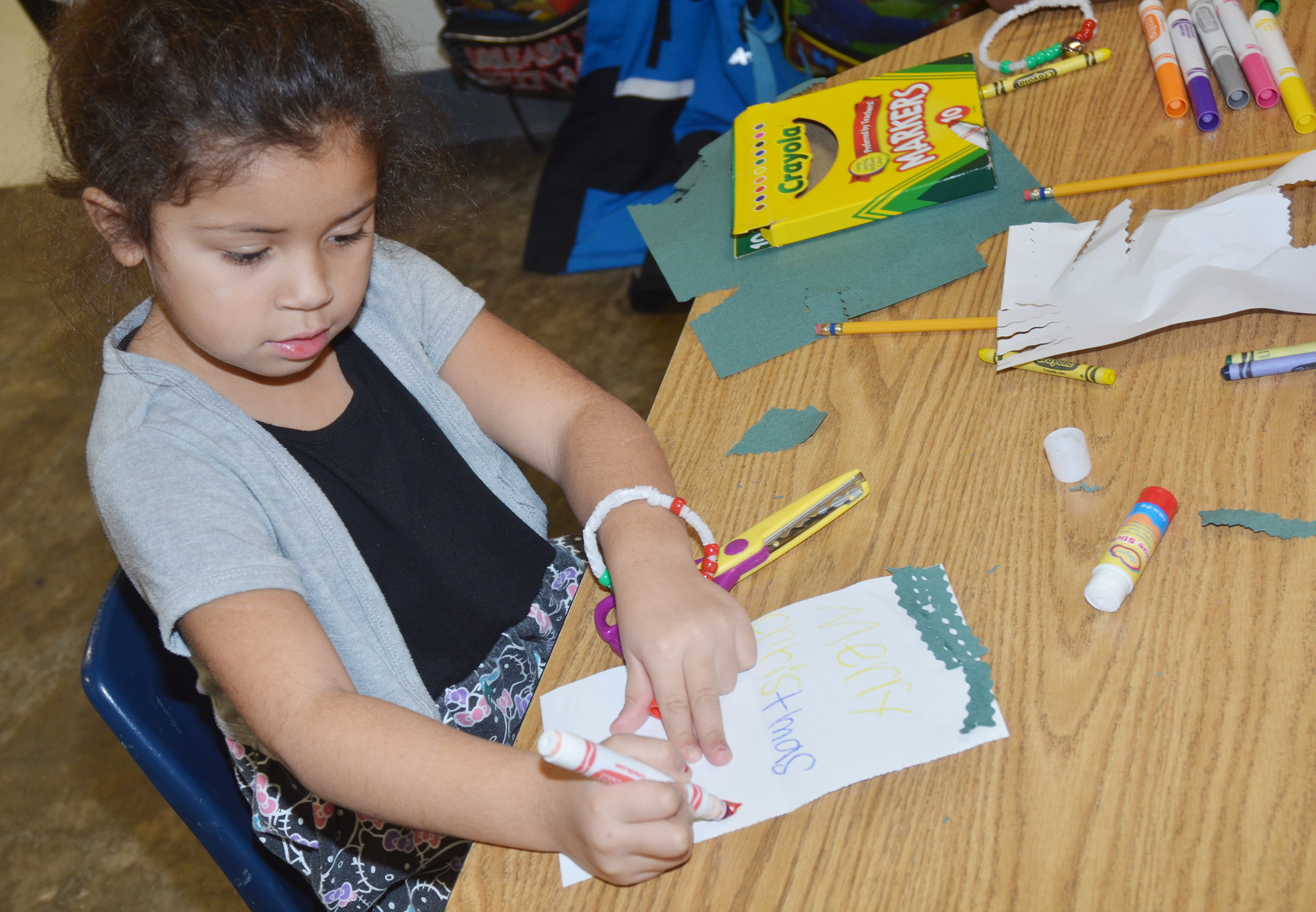 CES kindergartener Amiiyah Nunez makes a Christmas card.
