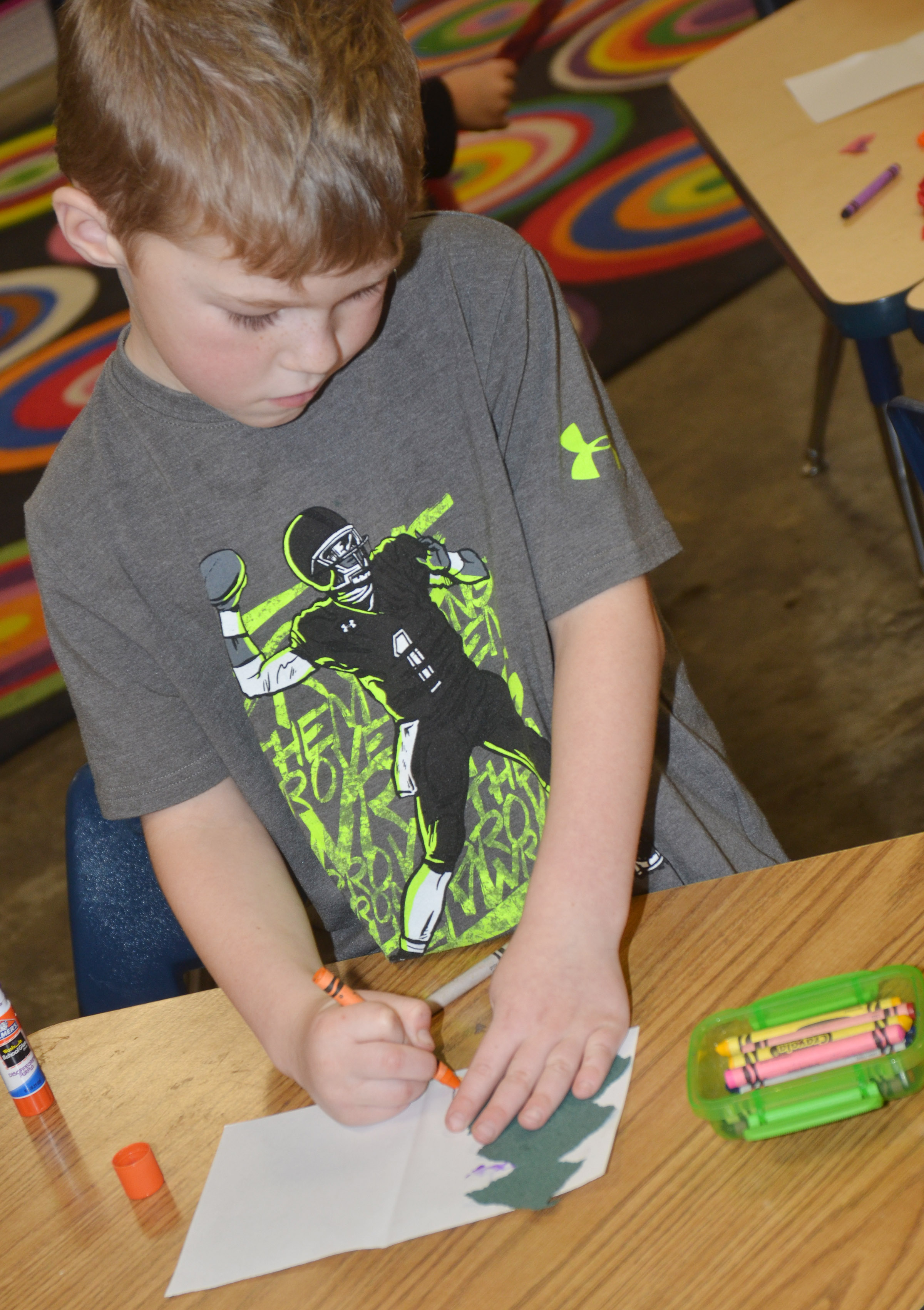 CES kindergartener Landry Brown makes a Christmas card.
