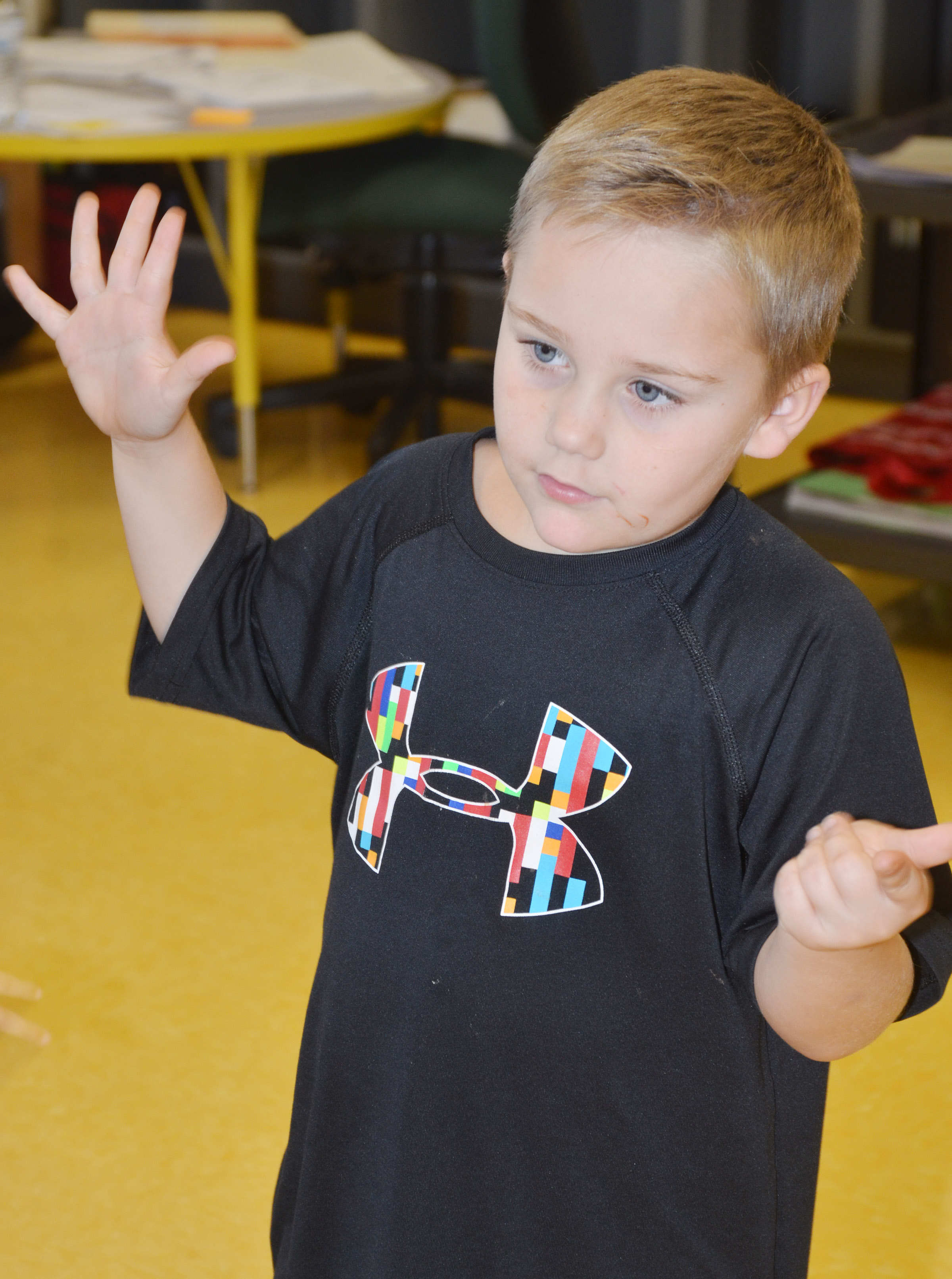 CES kindergartener Jacob Sandidge counts as he sings a Christmas song.