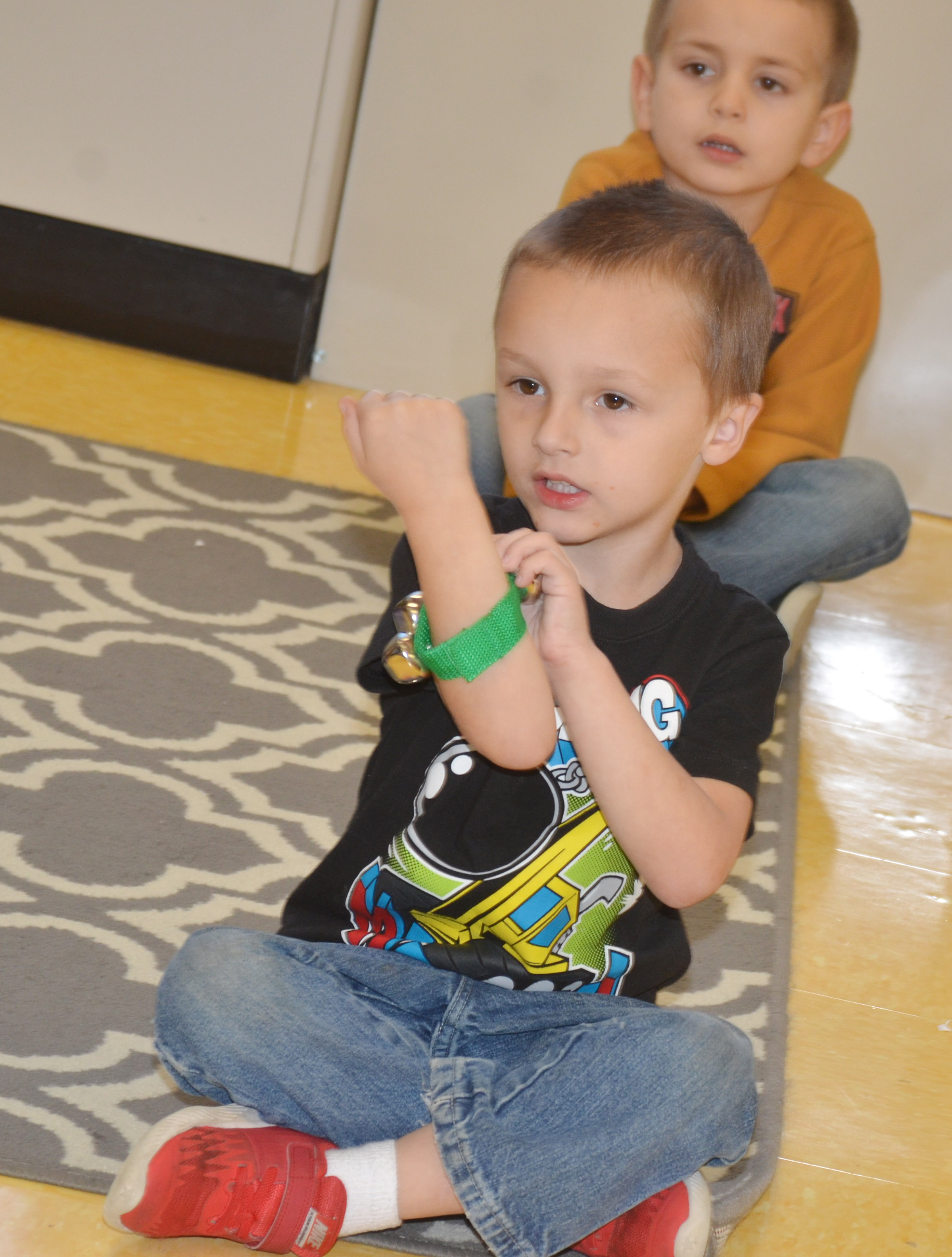 CES kindergartener Carter Ward shakes his jingle bell as he sings a Christmas song.