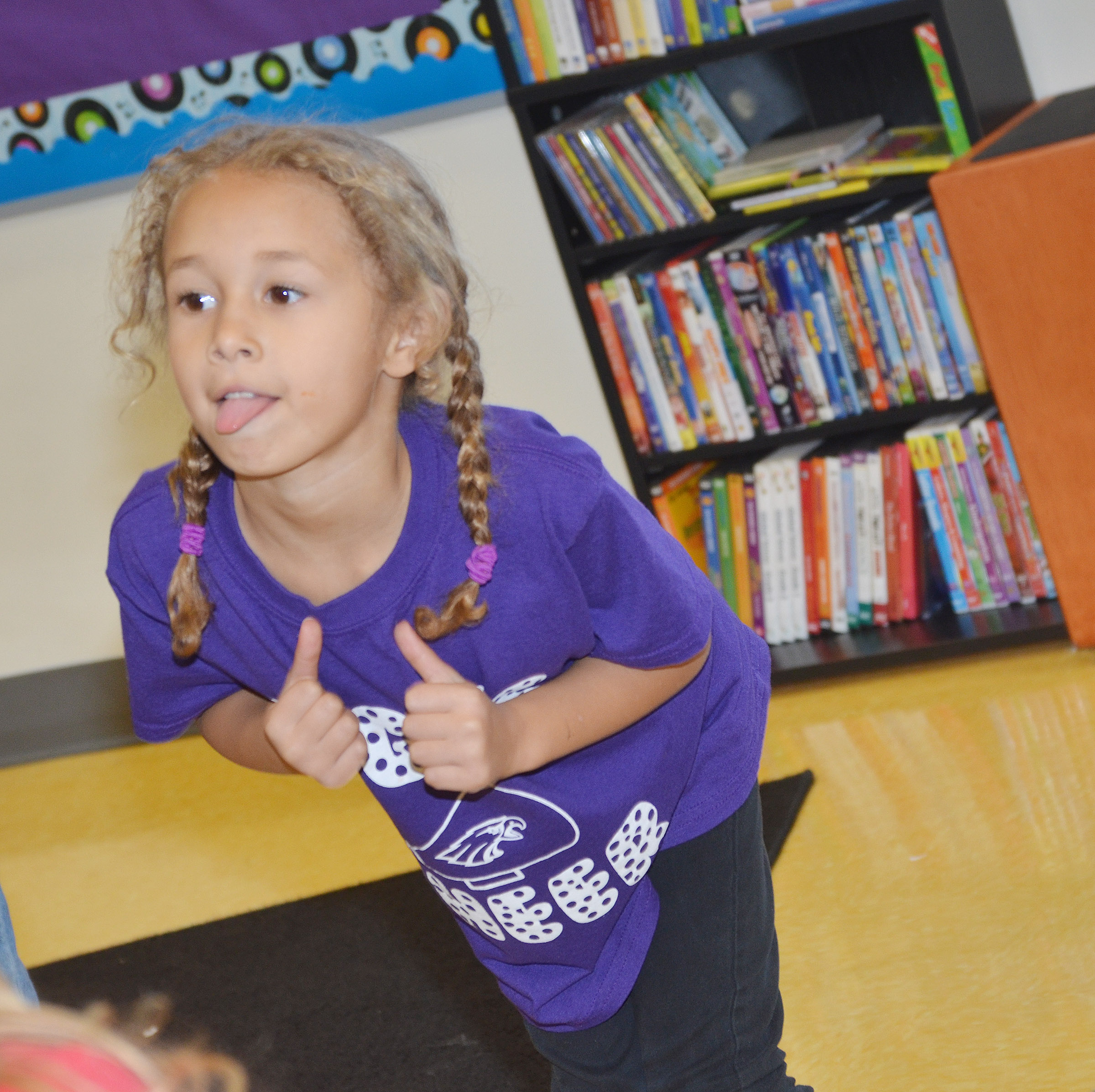 CES kindergartener Fallyn Smith sticks out her tongue as she dances to a Christmas song.