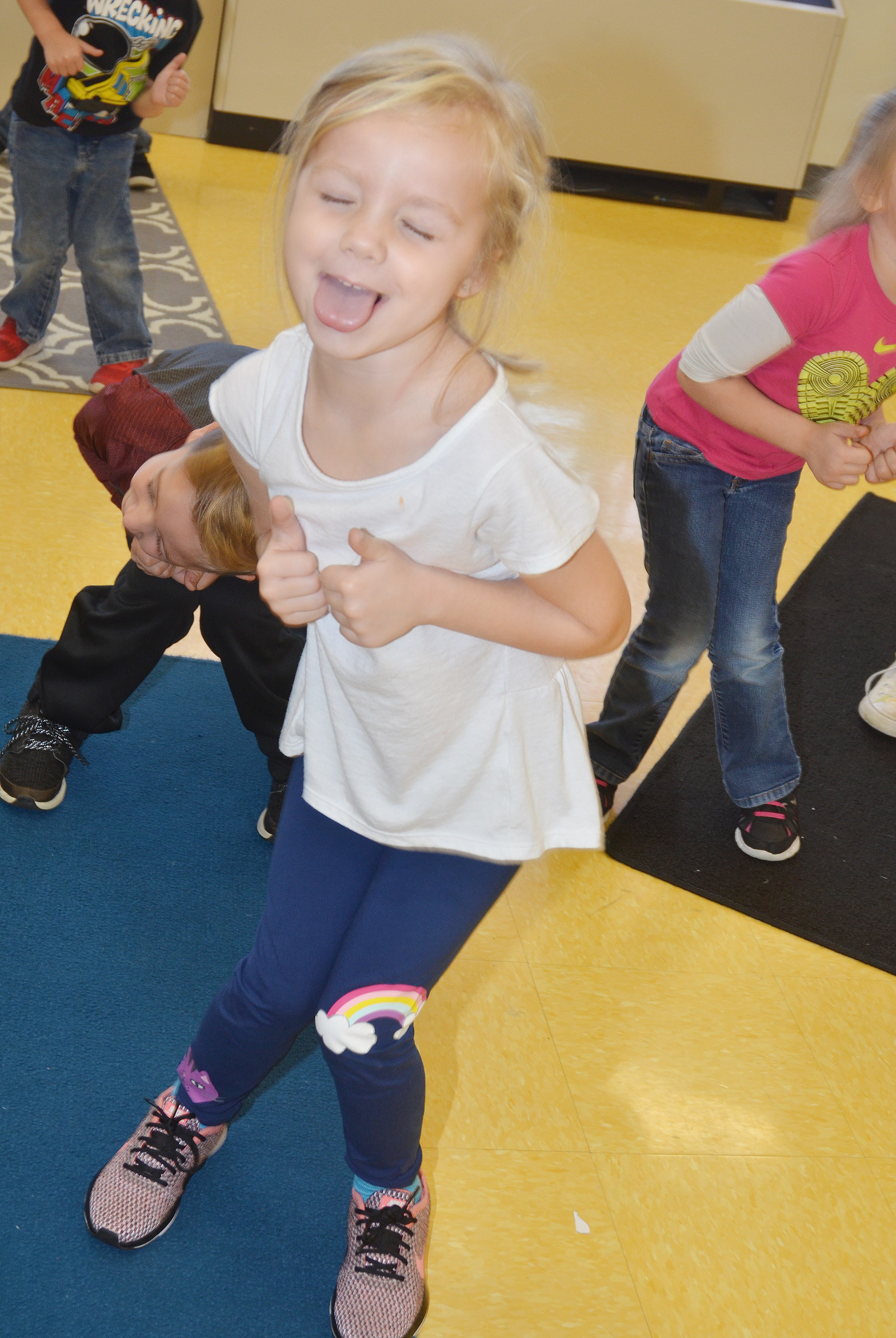 CES kindergartener Trinidy Gribbins shuts her eyes and sticks out her tongue as she dances to a Christmas song.
