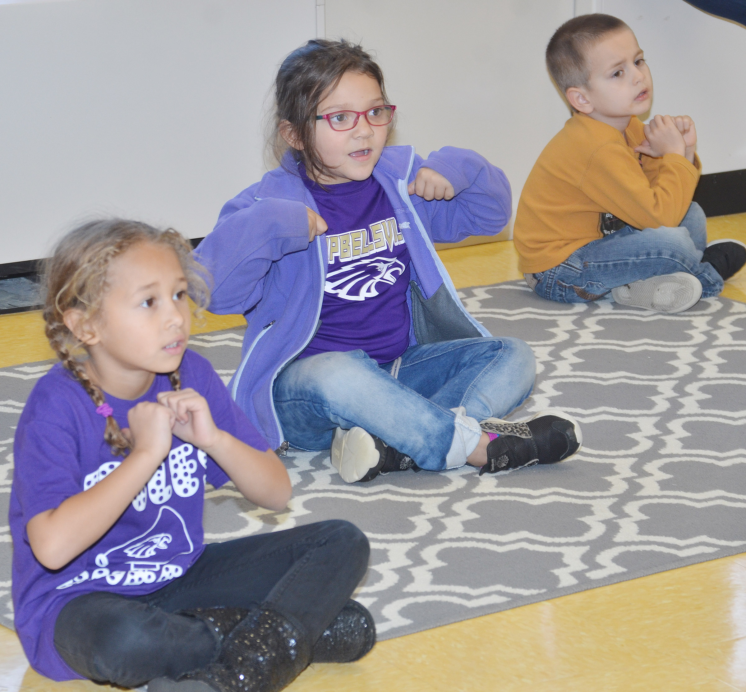 From left, CES kindergarteners Fallyn Smith, Addisyn Taylor and Samuel Terry sing a Christmas song.