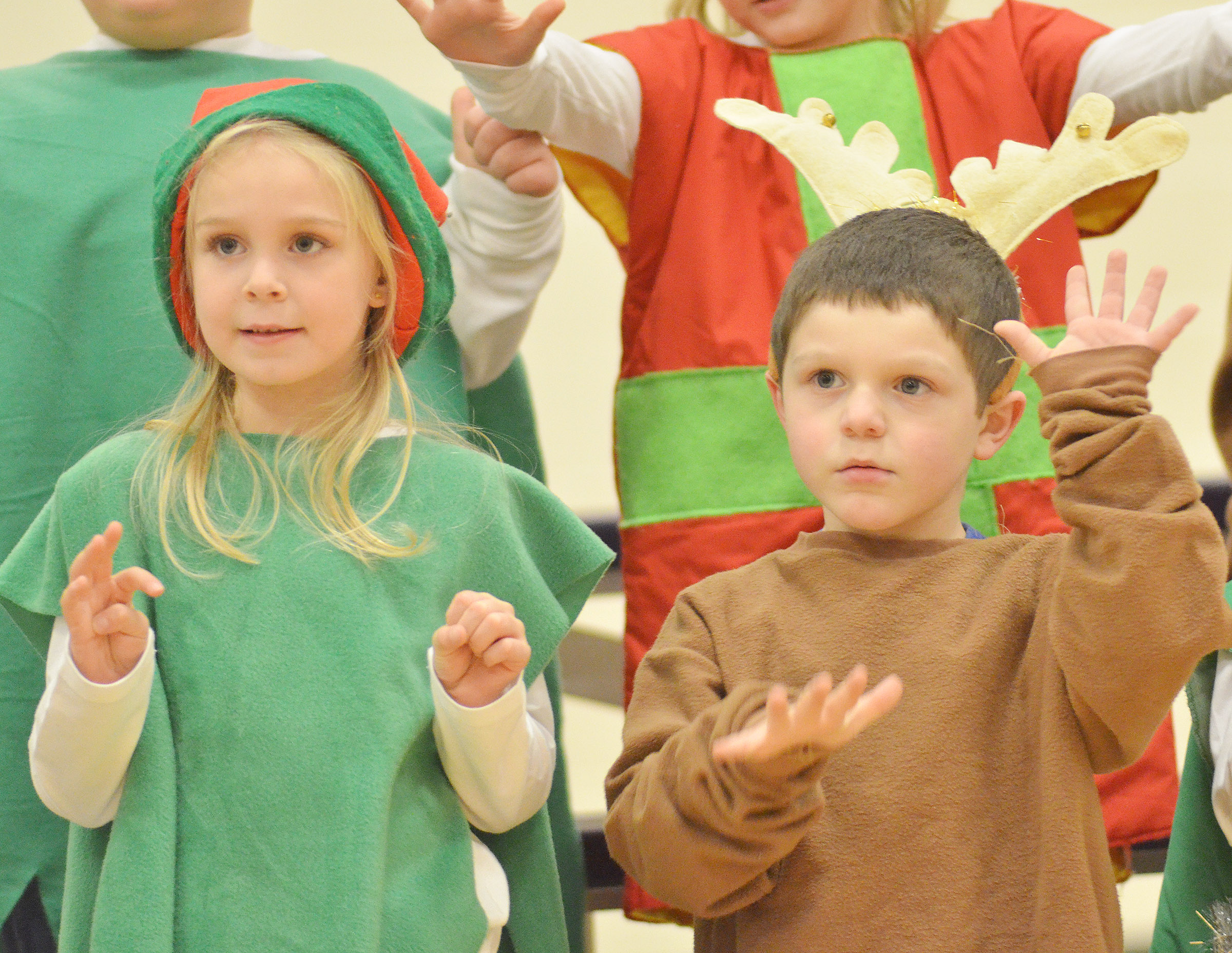 CES kindergarteners, from left, Alinna Bray and Michael Priddy sing.