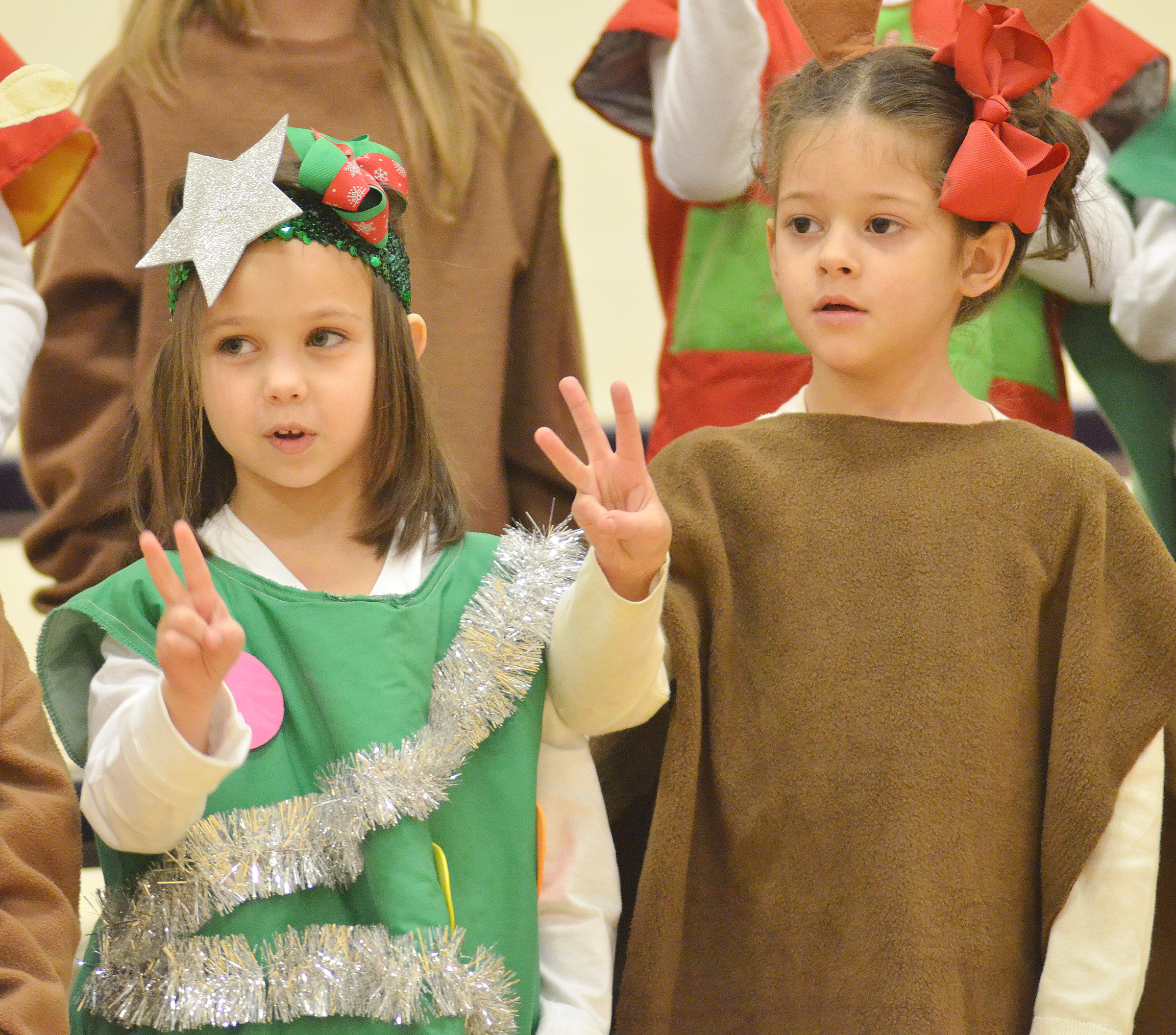 CES kindergarteners Tylee Britton, at left, and Norah Adkins sing.