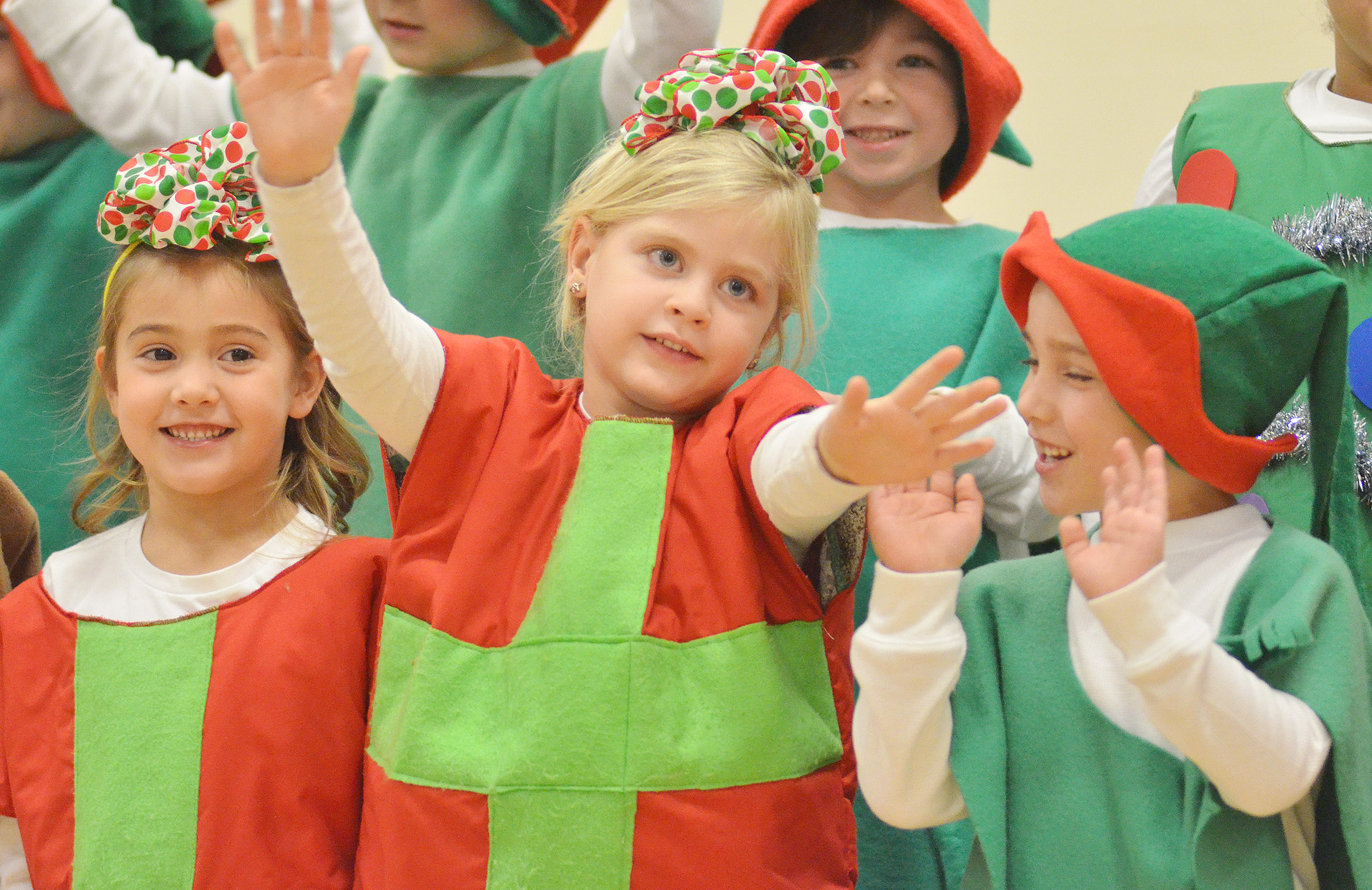 CES kindergarteners, from left, Blakely Gray, Remi Petett and Dane Gray sing and dance.