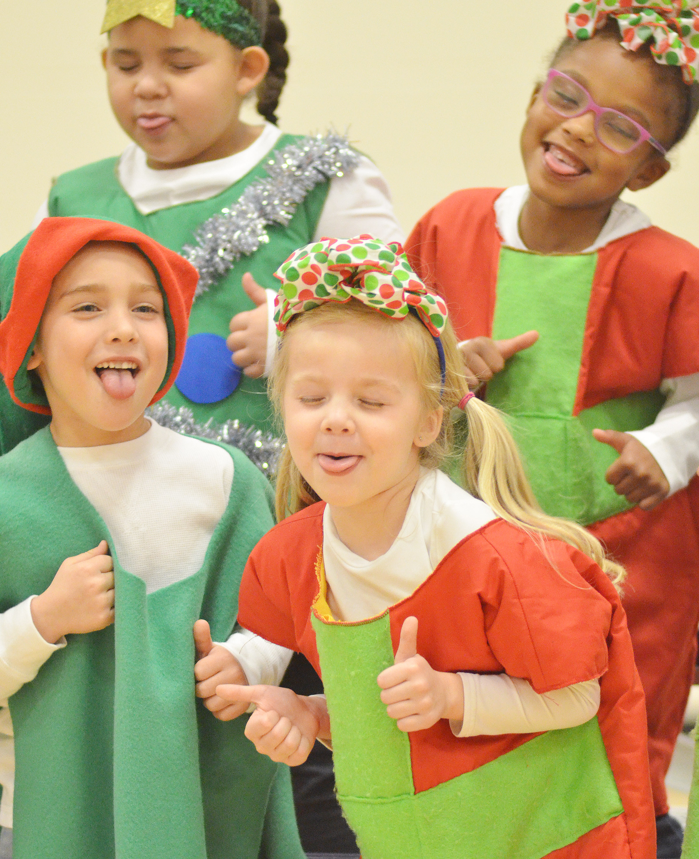 CES kindergarteners, from left, front, Dane Gray and Trinidy Gribbins, and, in back, Lillian Merriweather and Daya Griffin sing and dance.