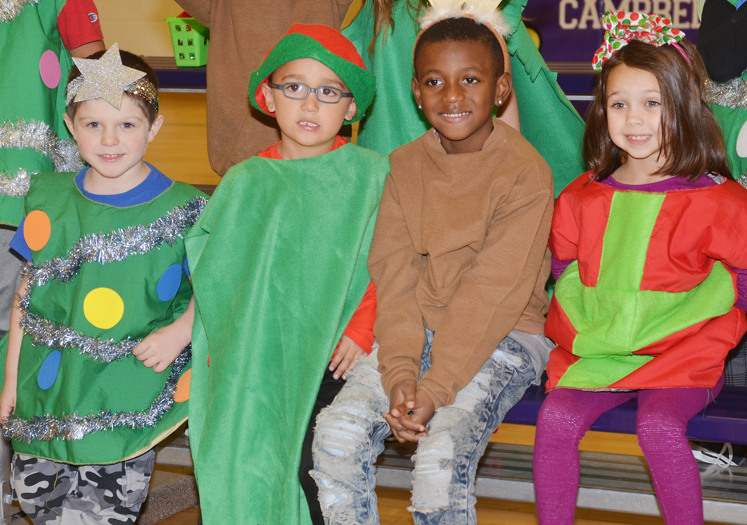 From left, CES kindergarteners Michael Priddy, Chanler Mann, Zyhaven Taylor and Tylee Britton smile before their Christmas program.