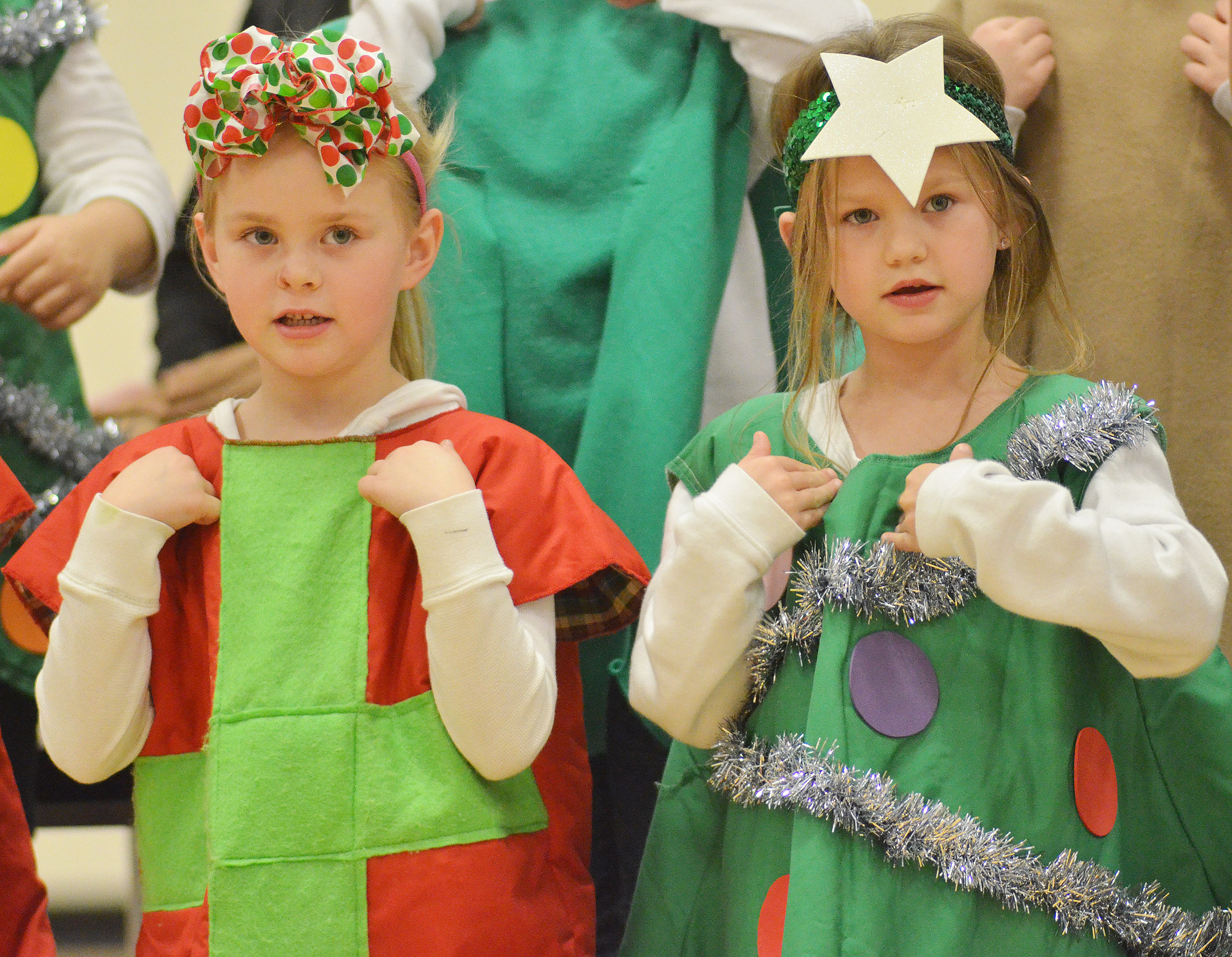 CES kindergarteners Ambie Edwards, at left, and Lilly Spencer sing and dance.