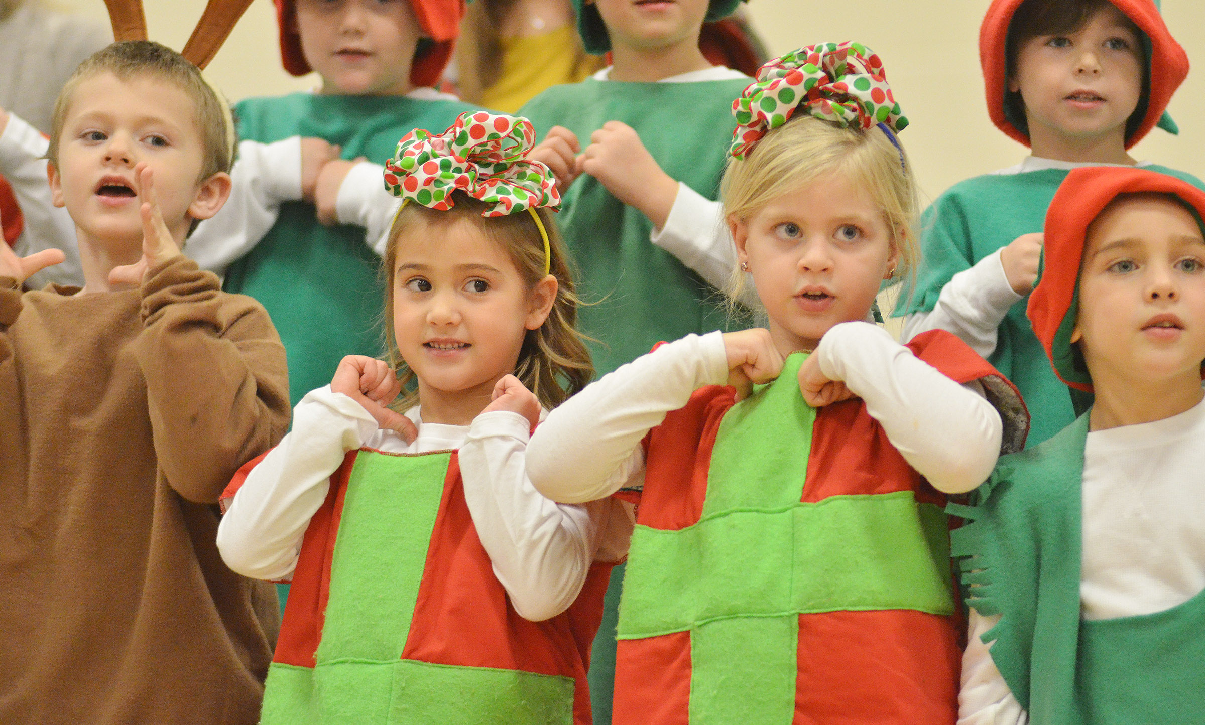 From left, CES kindergarteners Nicholas Wilson, Blakely Gray, Remi Petett and Dane Gray sing and dance.