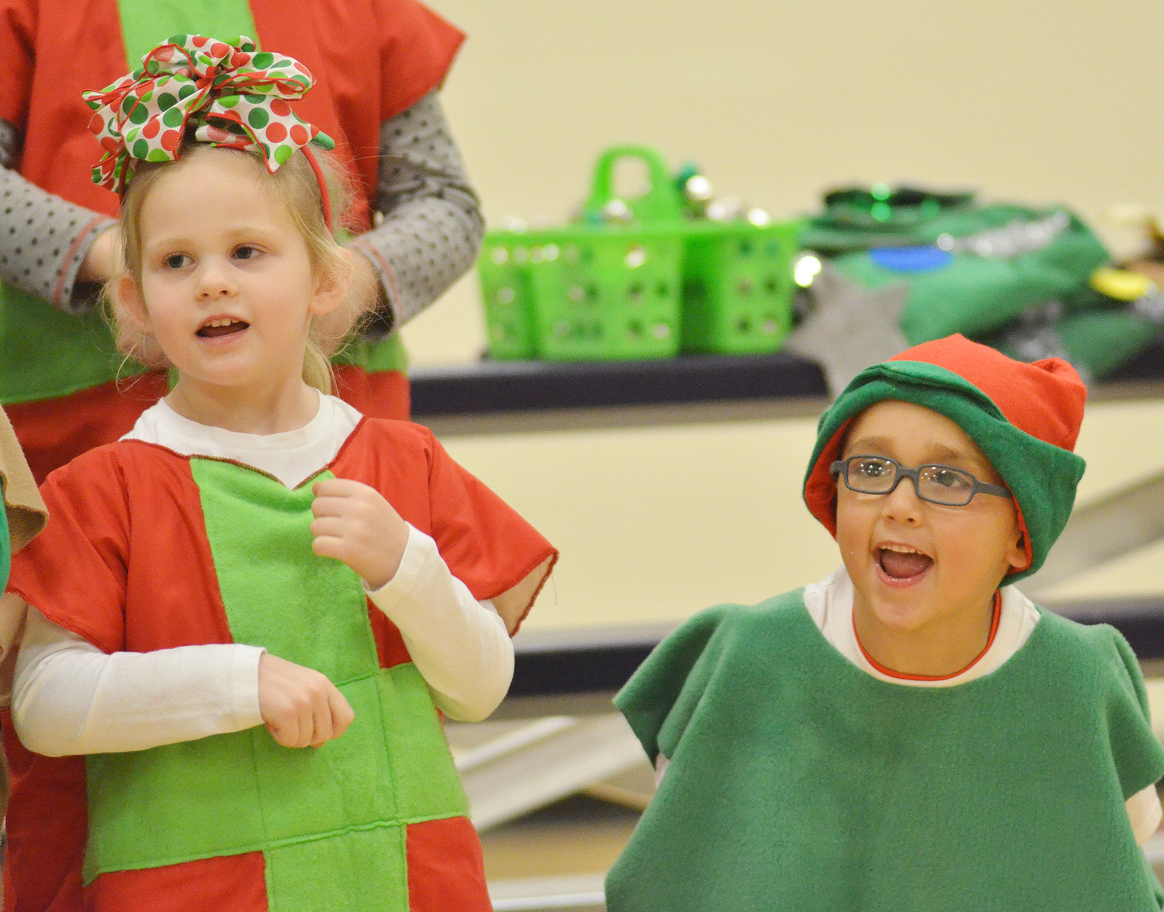CES kindergarteners, from left, Riley Bright and Chanler Mann sing and dance.