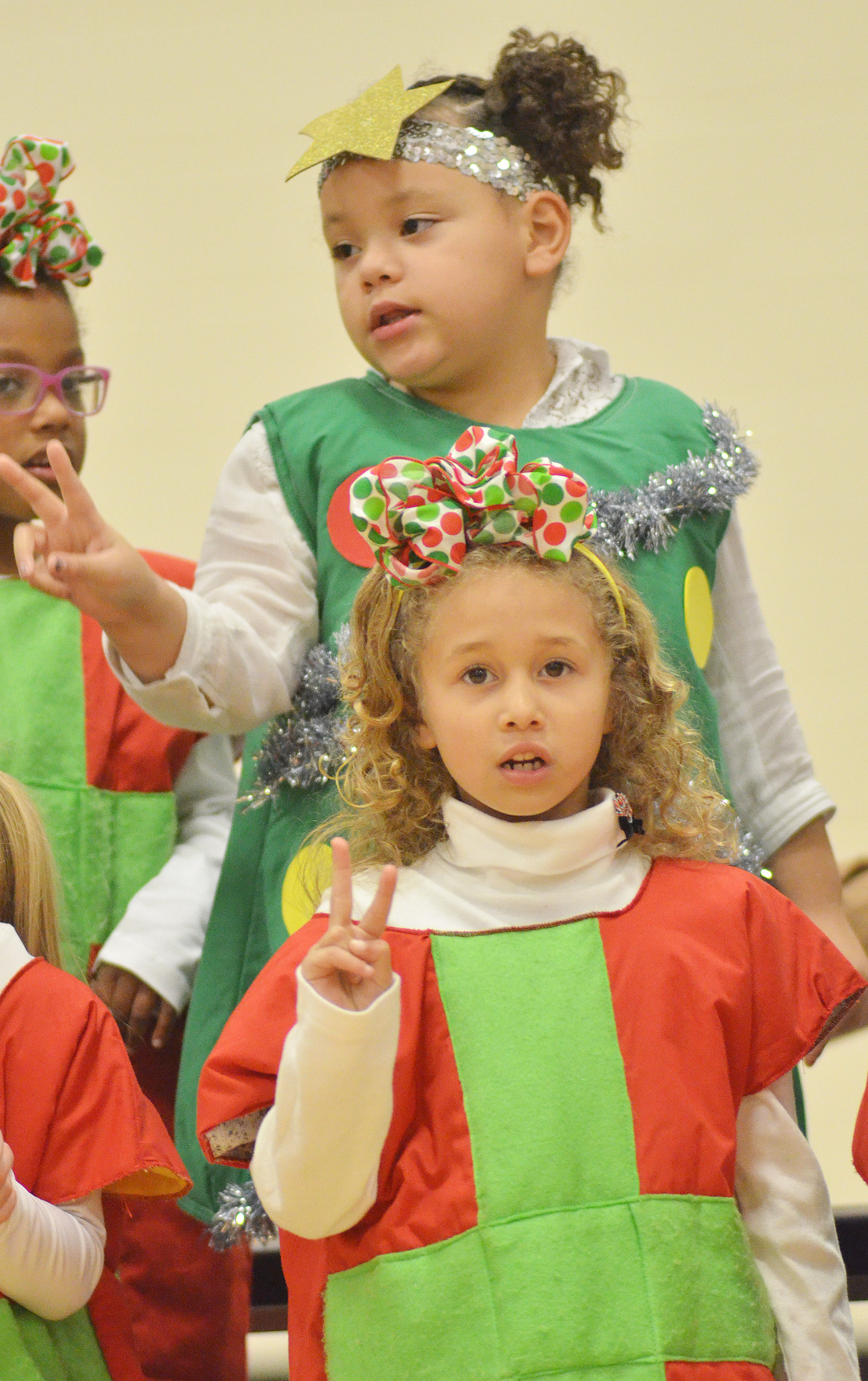 CES kindergarteners Fallyn Smith, in front, and Lillian Merriweather sing and dance.