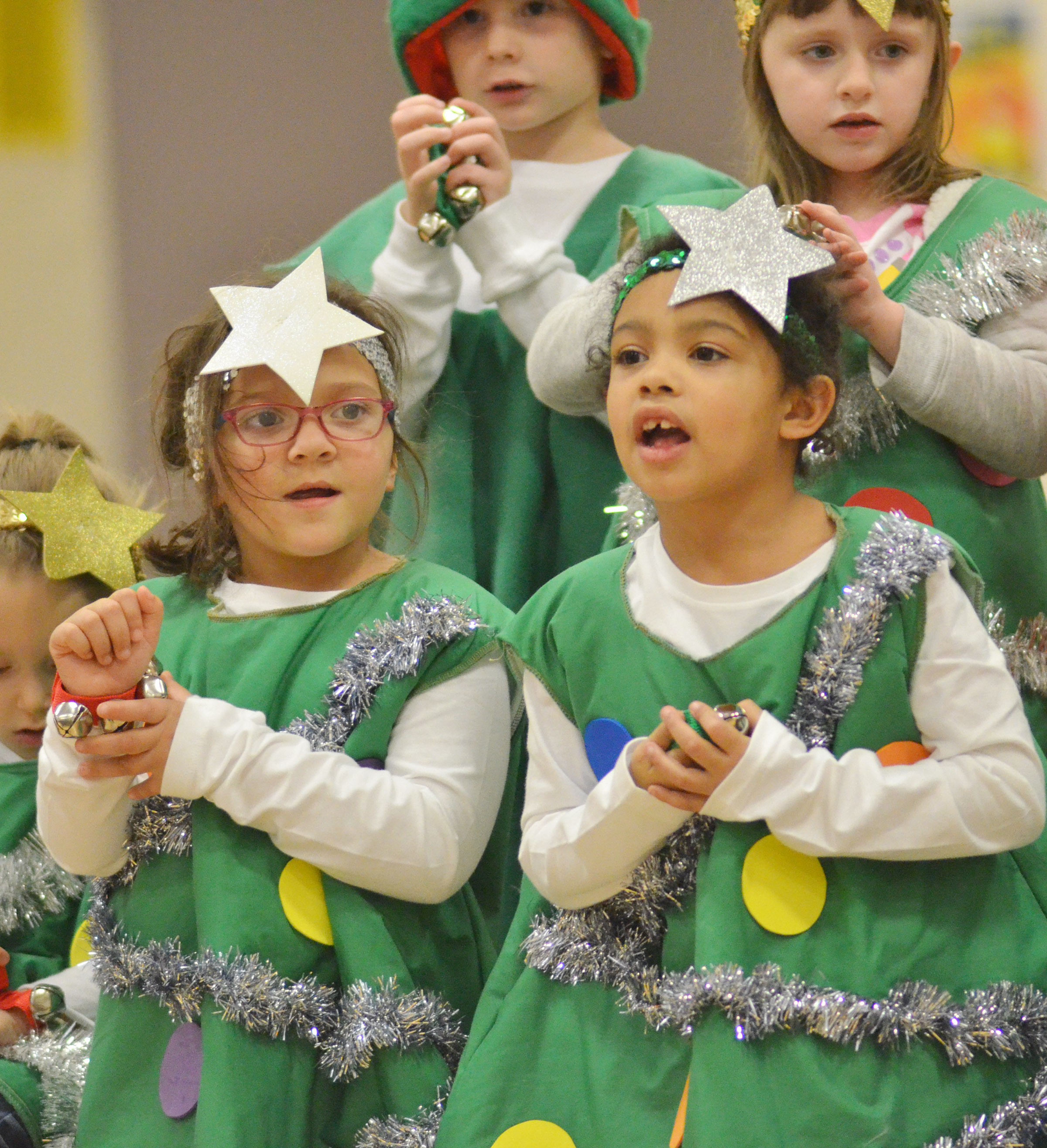 CES kindergarteners Addisyn Taylor, at left, and Rylee Karr sing and dance.