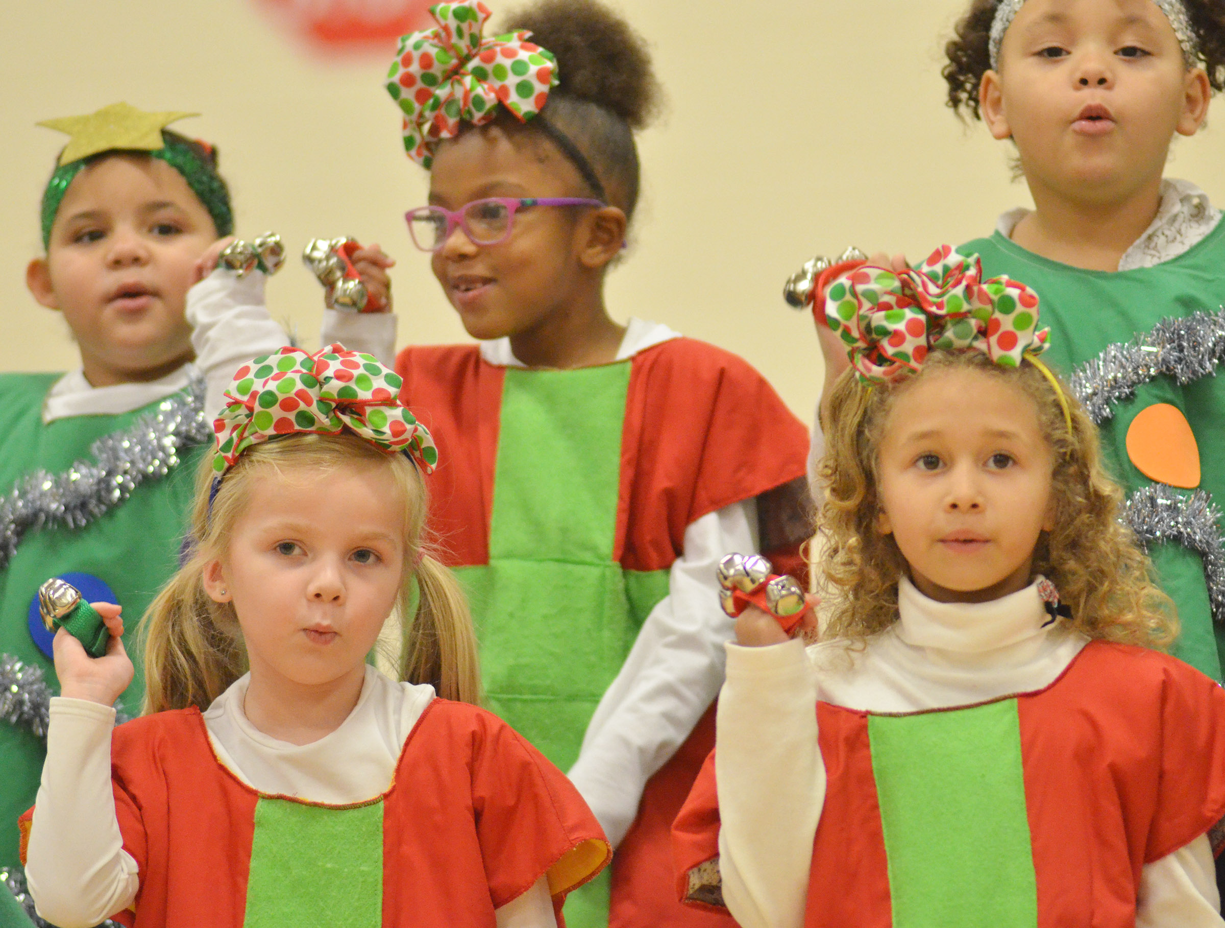 CES kindergarteners, from left, front, Trinidy Gribbins and Fallyn Smith, and, in back, Tatum Hoskins, Daya Griffin and Lillian Merriweather sing and dance.