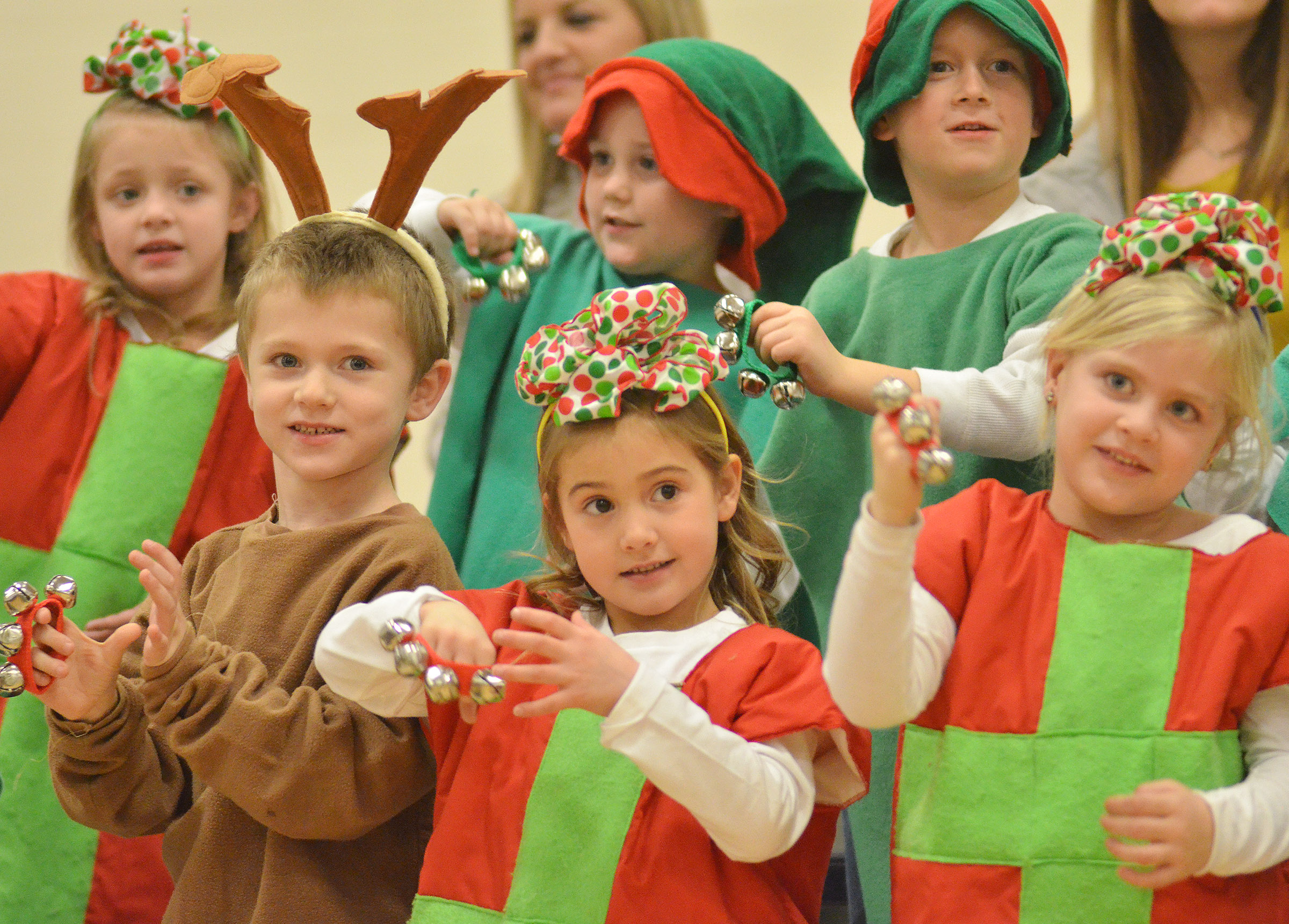 CES kindergarteners, from left, Nicholas Wilson, Blakely Gray and Remi Petett sing and dance. In back are Aliyah Garrett, Jacob Sandidge and Jacob Parrish.