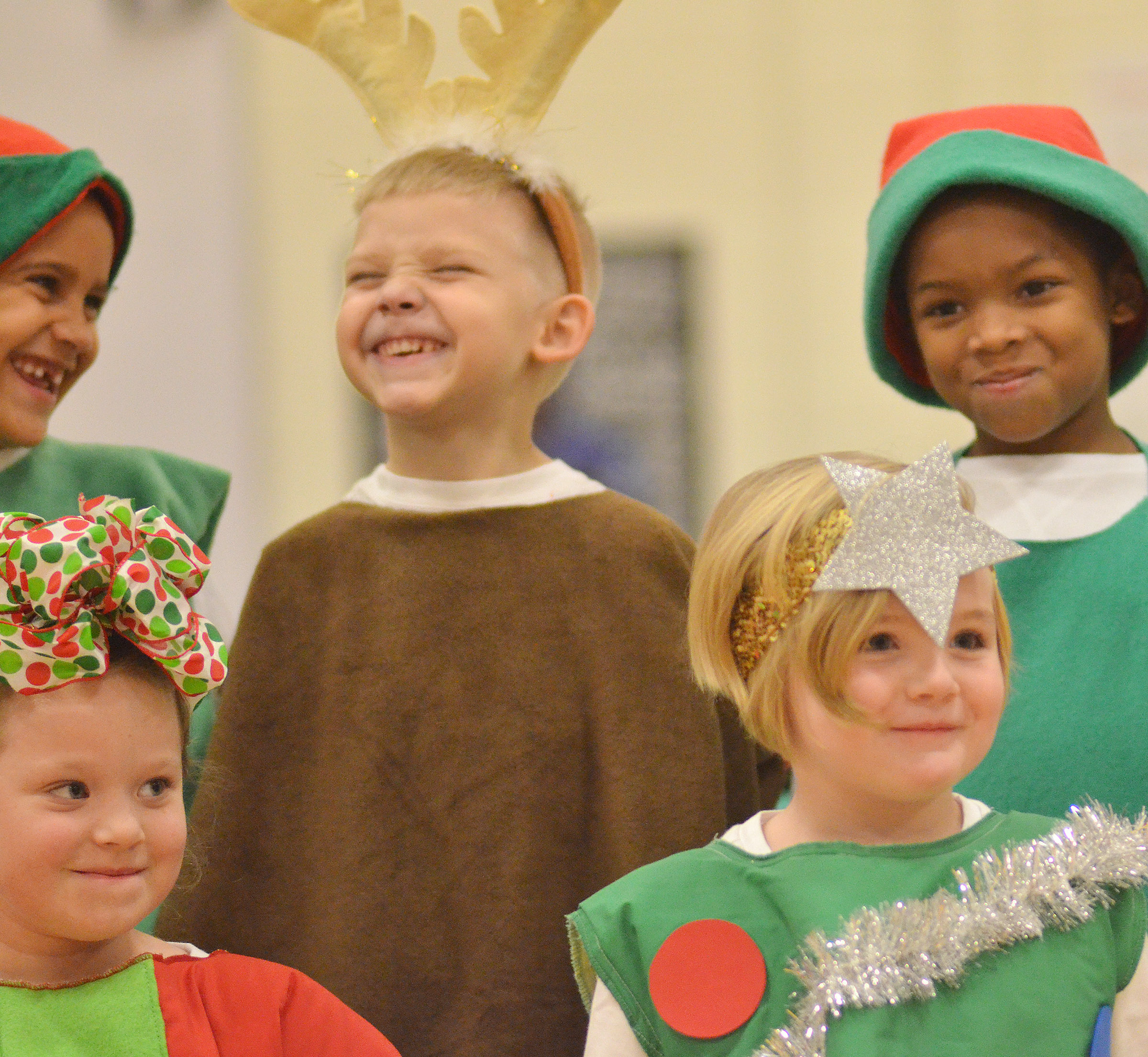 CES kindergarteners, from left, front, Gracie McKenzie and Zoe Scharbrough smile as they get ready to perform. In back are Kingstown Cowherd, Jeremiah Stebelton and Kaiyden Vancleave.