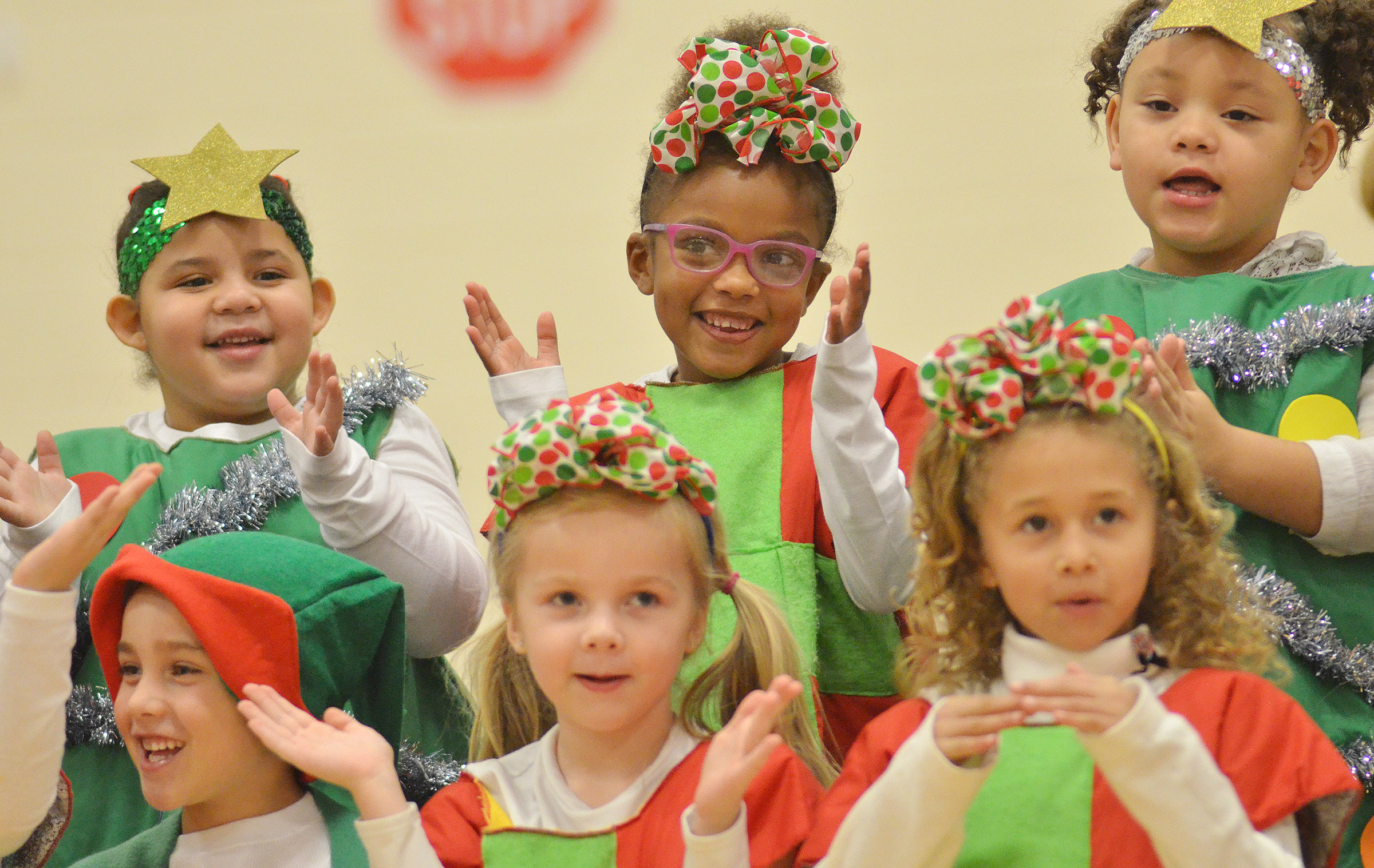CES kindergarteners smile as they sing a Christmas song. From left, front, are Dane Gray, Trinidy Gribbins and Fallyn Smith. Back, Tatum Hoskins, Daya Griffin and Lillian Merriweather.