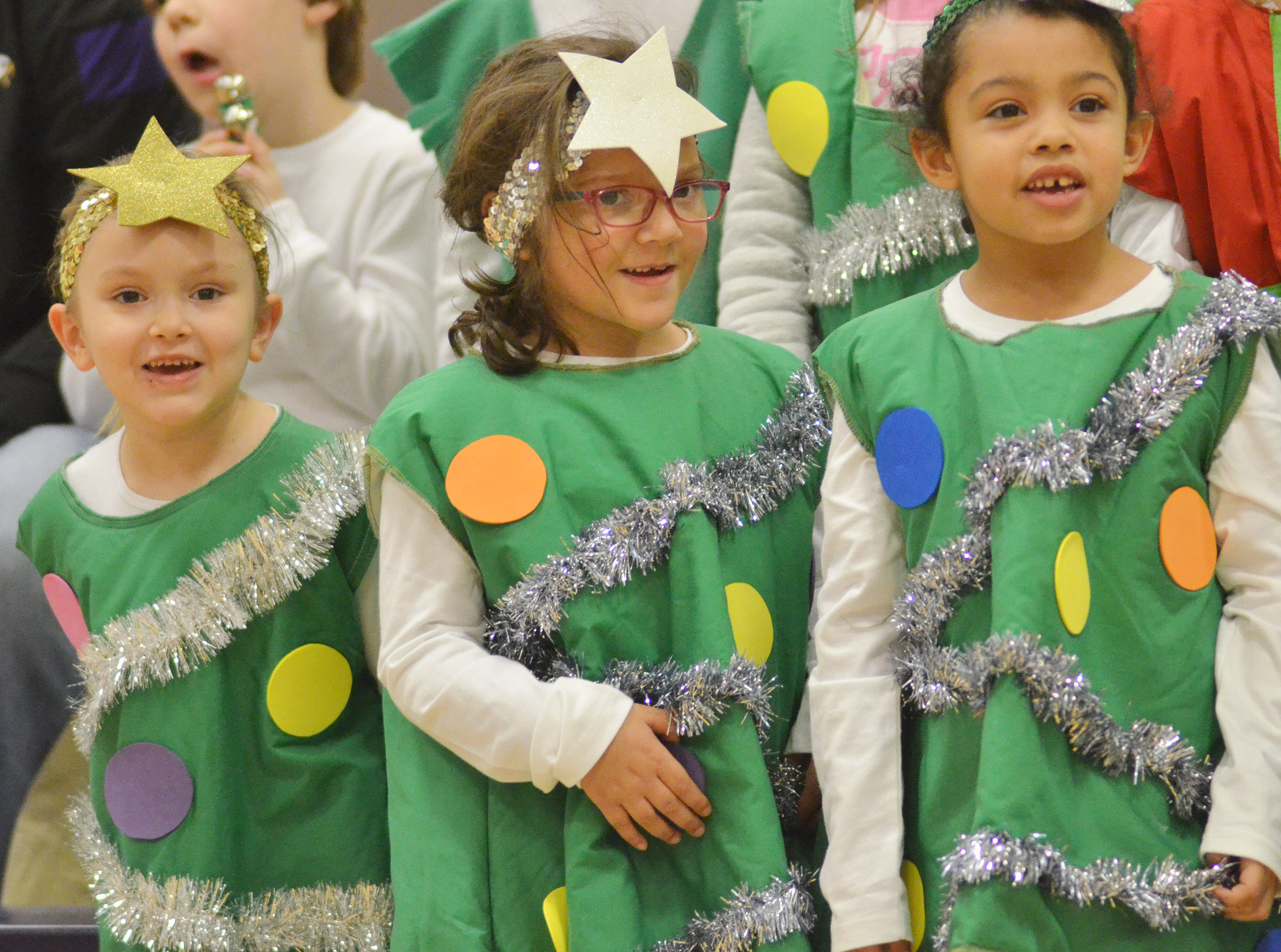 From left, CES kindergarteners Myah Learmond, Addisyn Taylor and Rylee Karr sing.