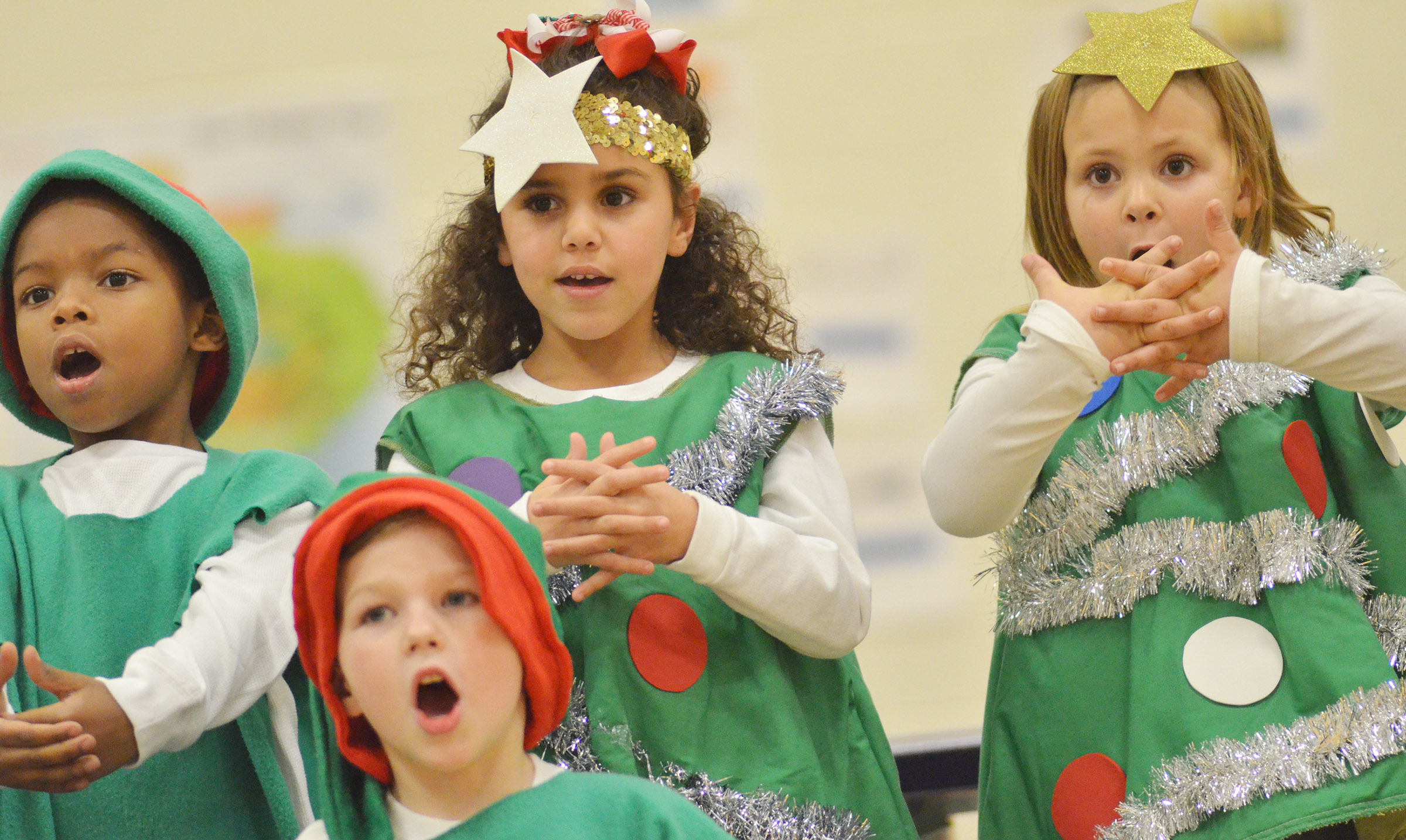 From left, CES kindergarteners Kaiyden Vancleave, Adelyn Litsey and Alaziah Smith sing. In front is Landry Brown.