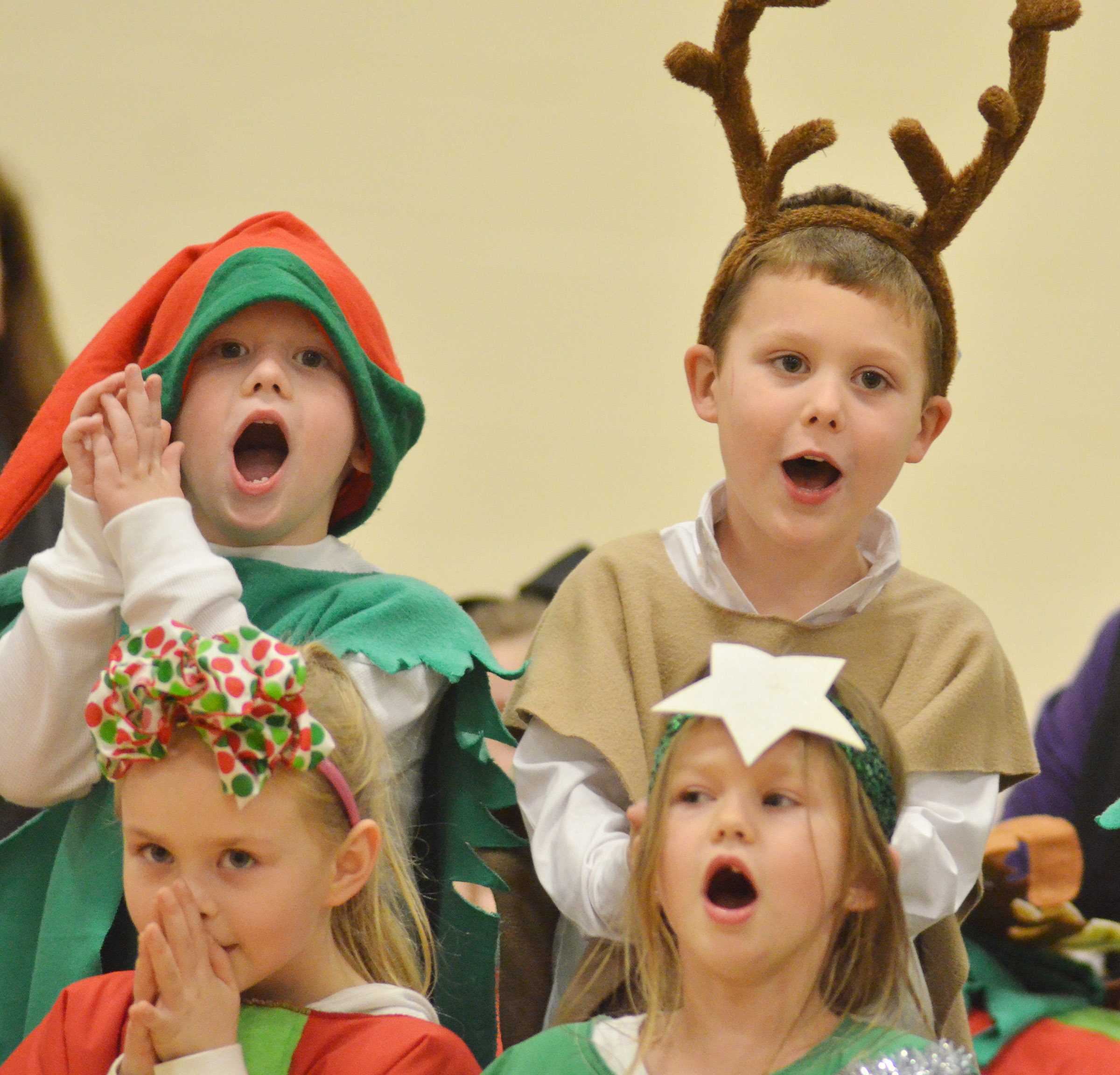 CES kindergarteners, from left, front, Ambie Edwards and Lilly Spencer sing. In back are Abel Wilson and Kyler Wilson.
