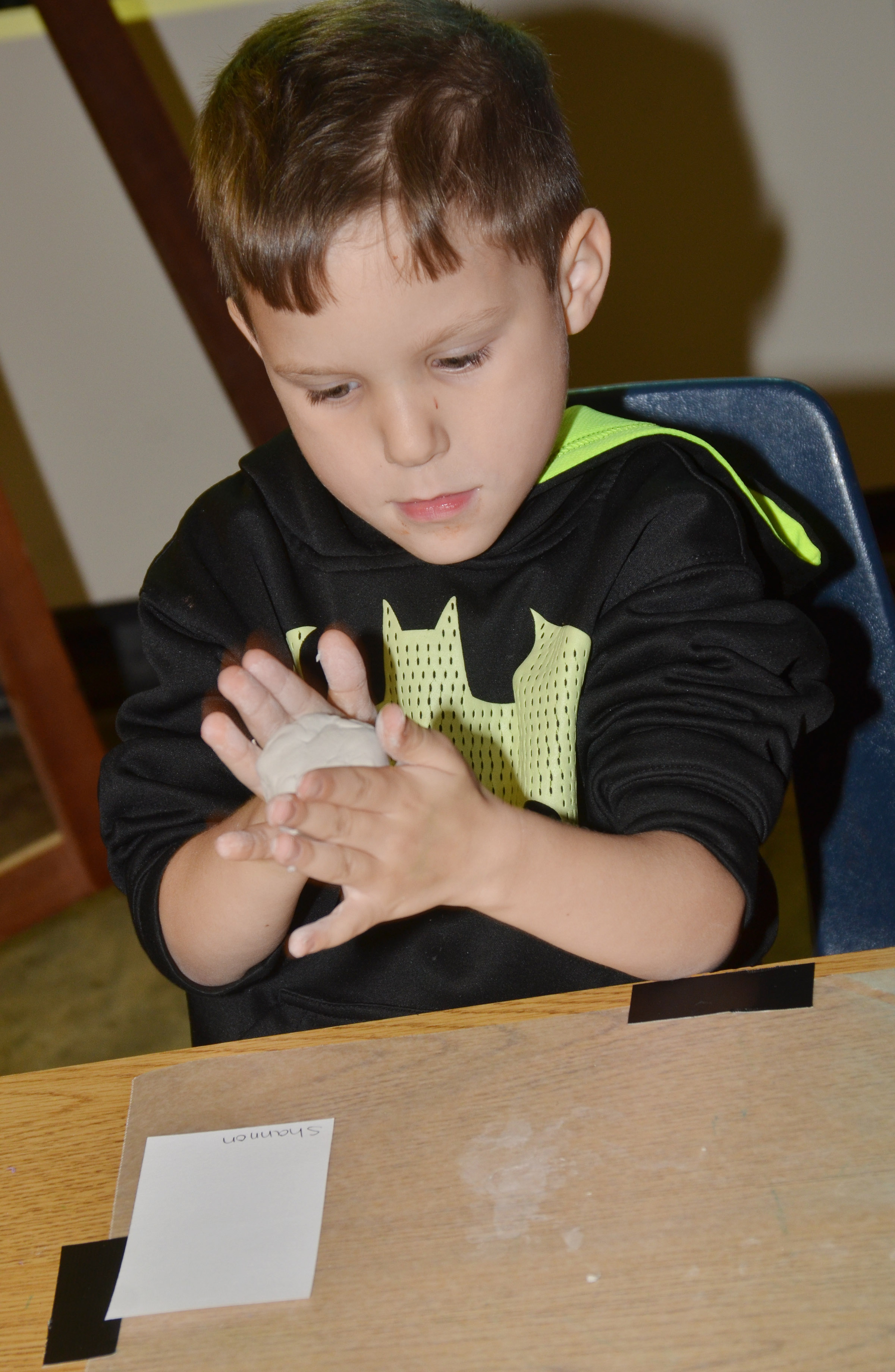CES kindergartener Shannon Carmicle rolls his clay.
