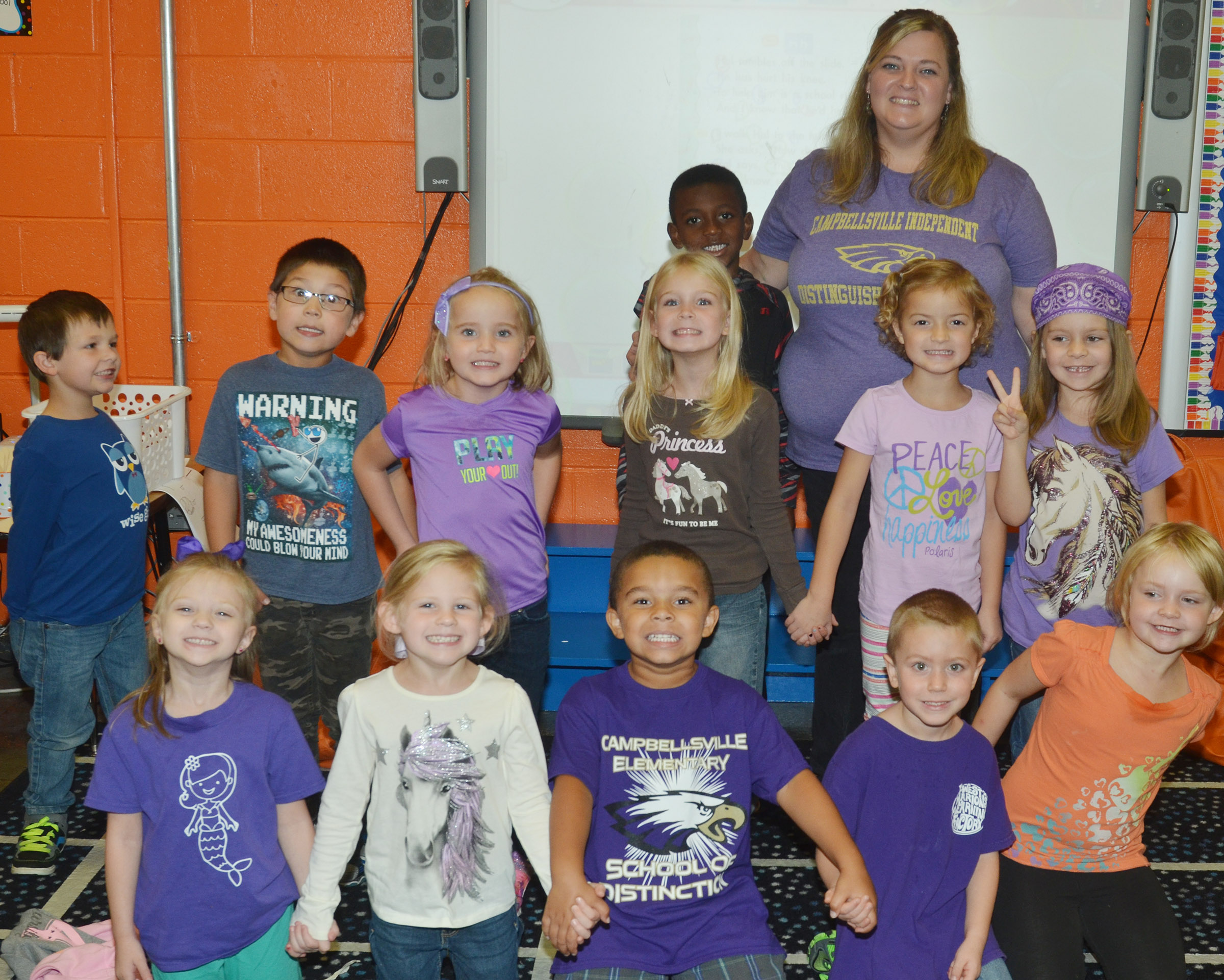 CES kindergarteners in Kimberly Clark's class wear purple for Color Week.