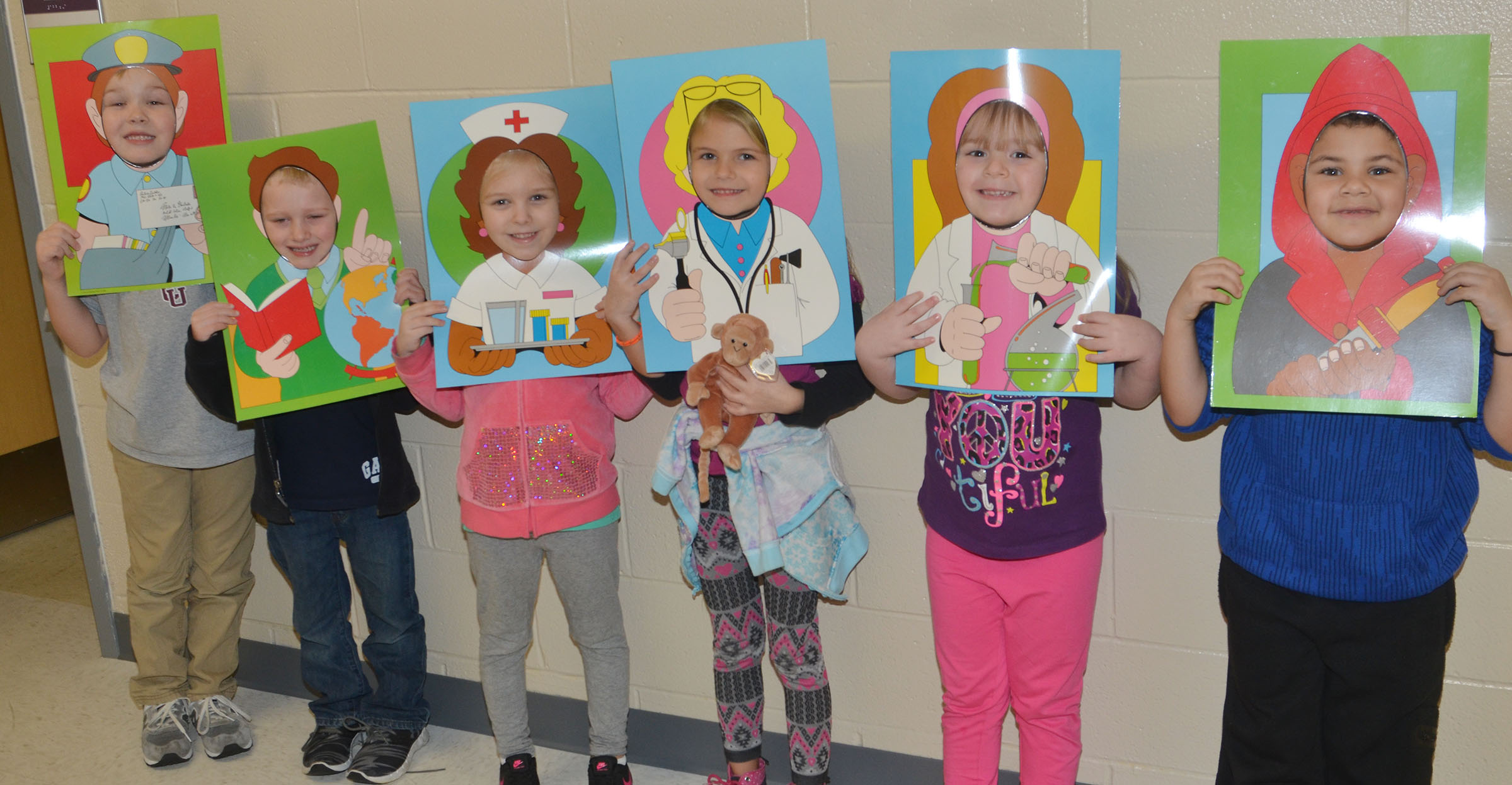 CES kindergarteners pose as the community helpers they hope to be when they grow older. From left are John Hagan Newton, Jackson Wright, Aubrey Novak, Gracie Gebler, Briley Sapp and NyJah Vaught.
