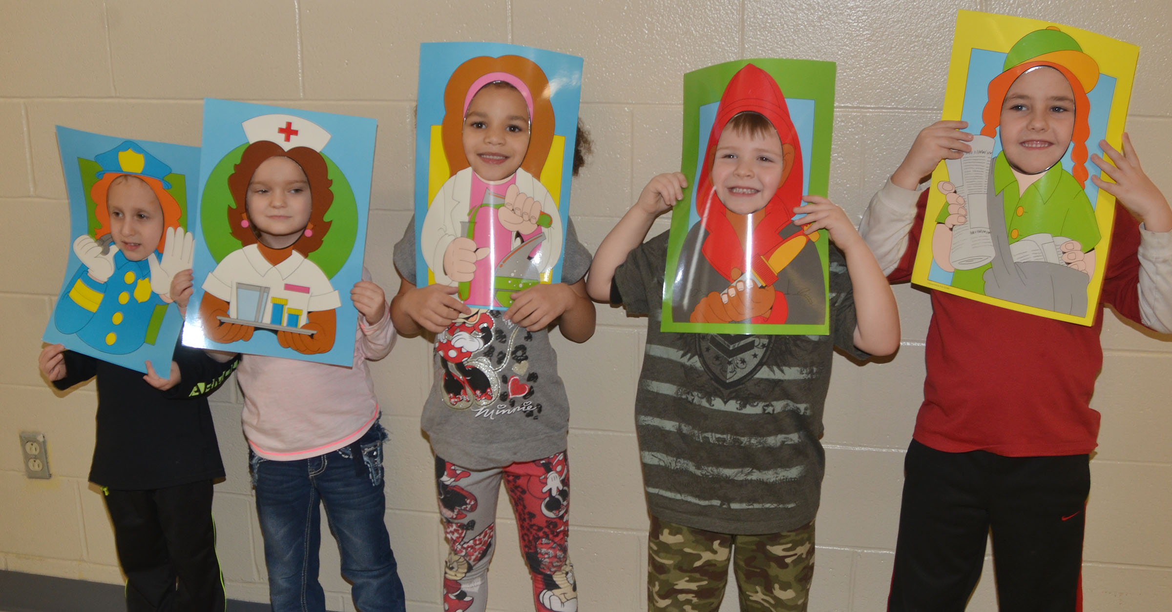 CES kindergarteners pose as the community helpers they hope to be when they grow older. From left are Gavin Paris, Miley Orberson, Aleeya Spaulding, Enrique McDonald and Braxton Rhodes.