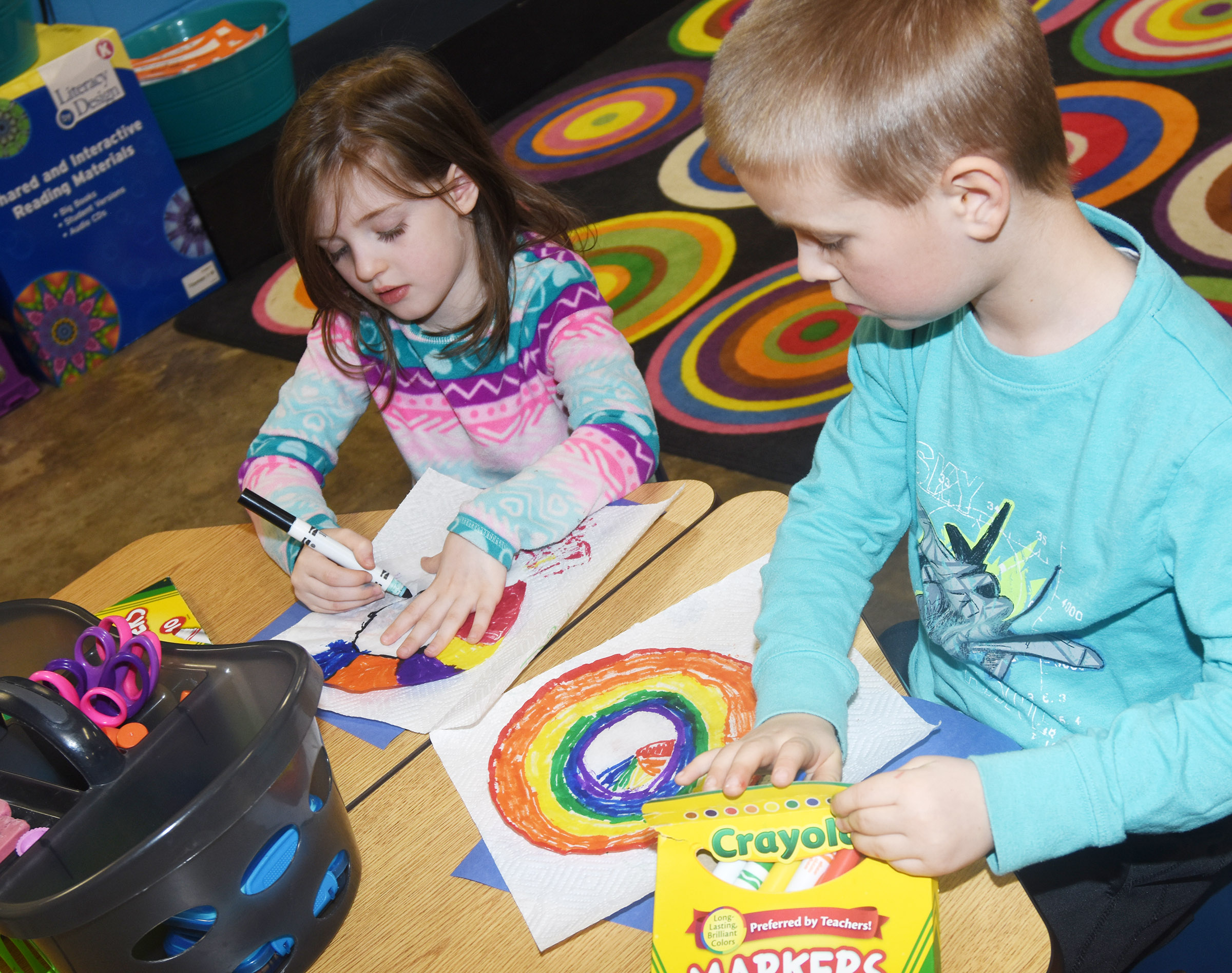 CES kindergarteners Lasca Martin, at left, and Jacob Parrish color their truffula trees.