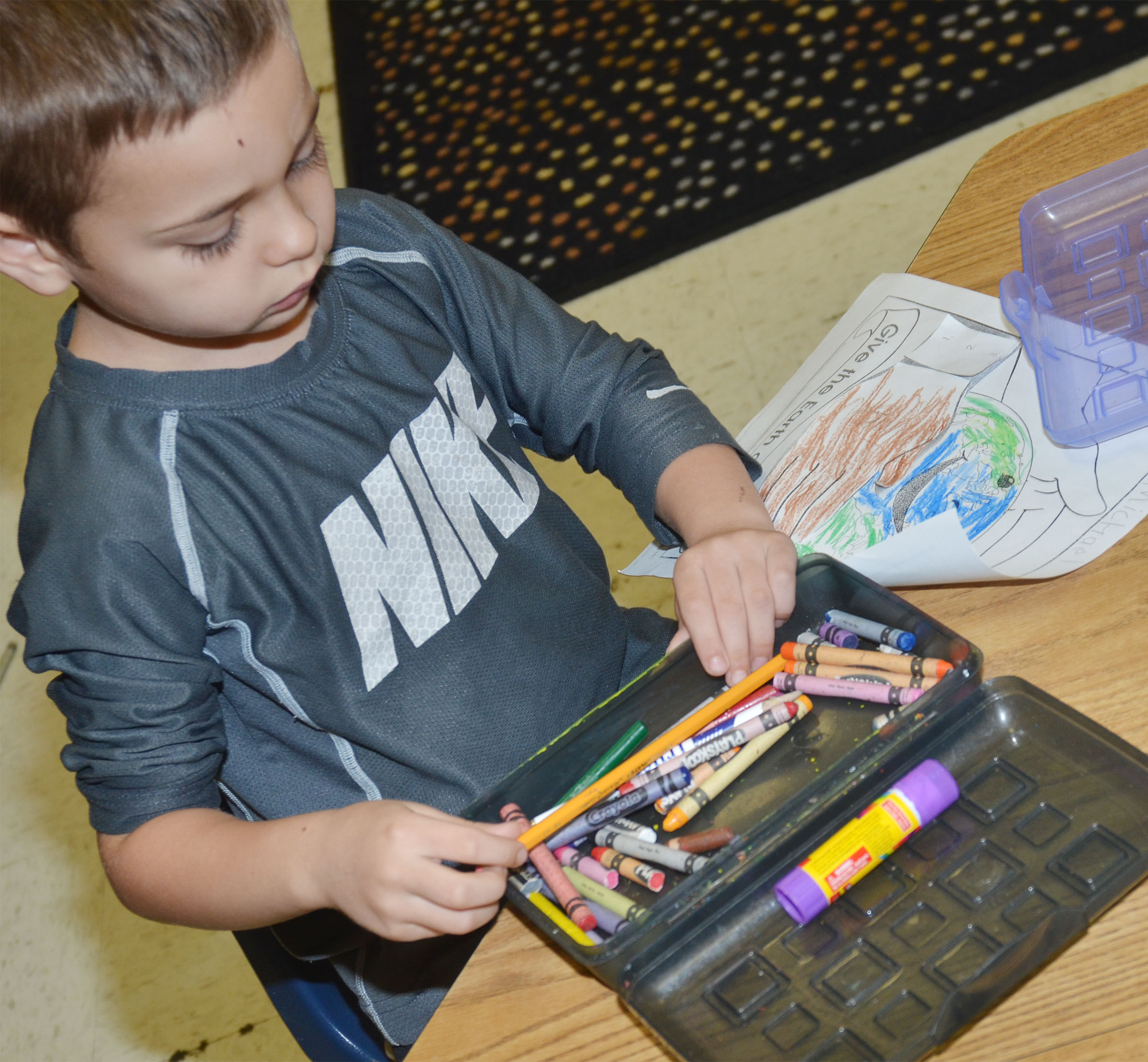 CES kindergartener Michael Terry colors a picture of the Earth.