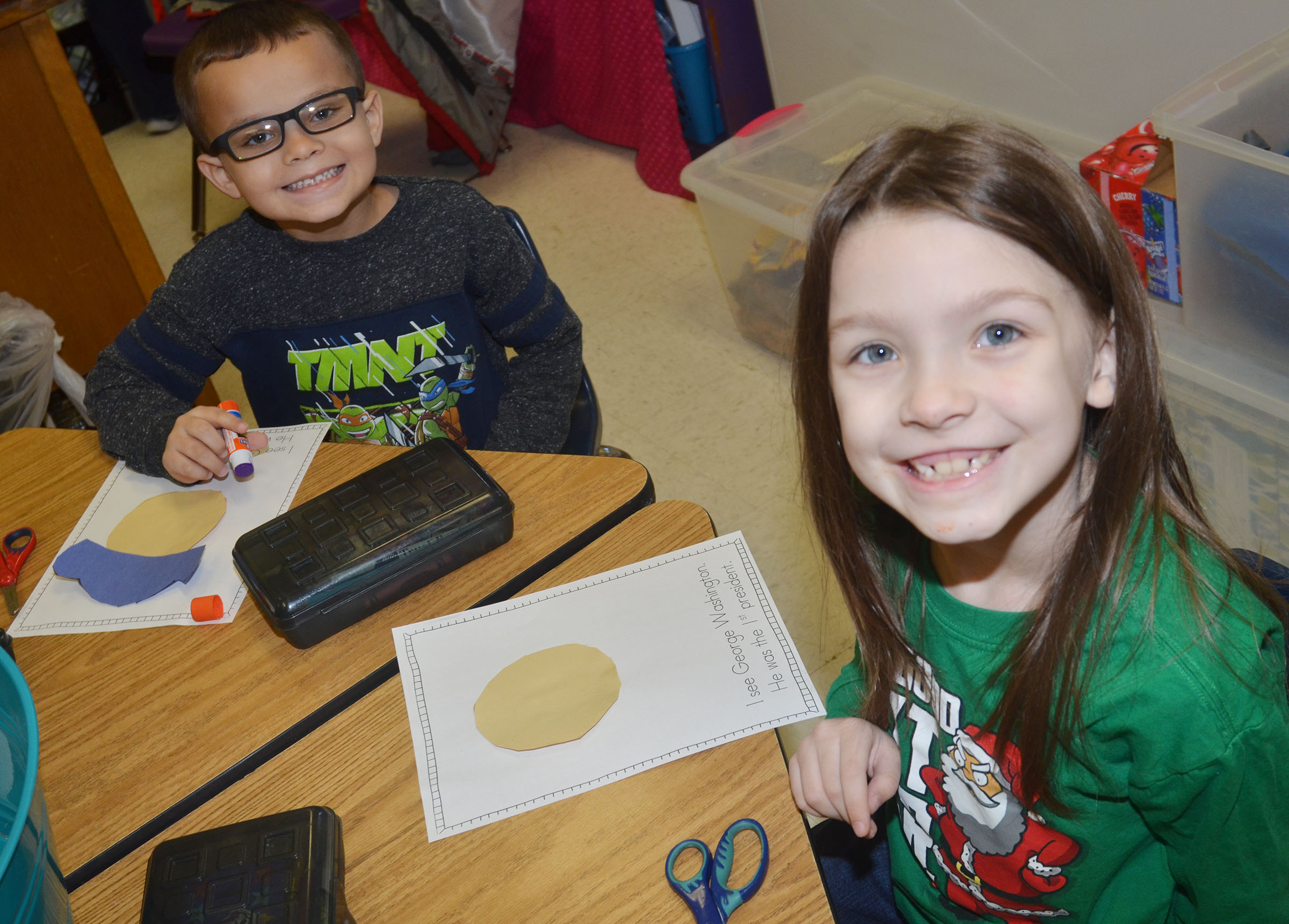 CES kindergarteners Davian Taylor, at left, and Melody Ward make their George Washington figures.